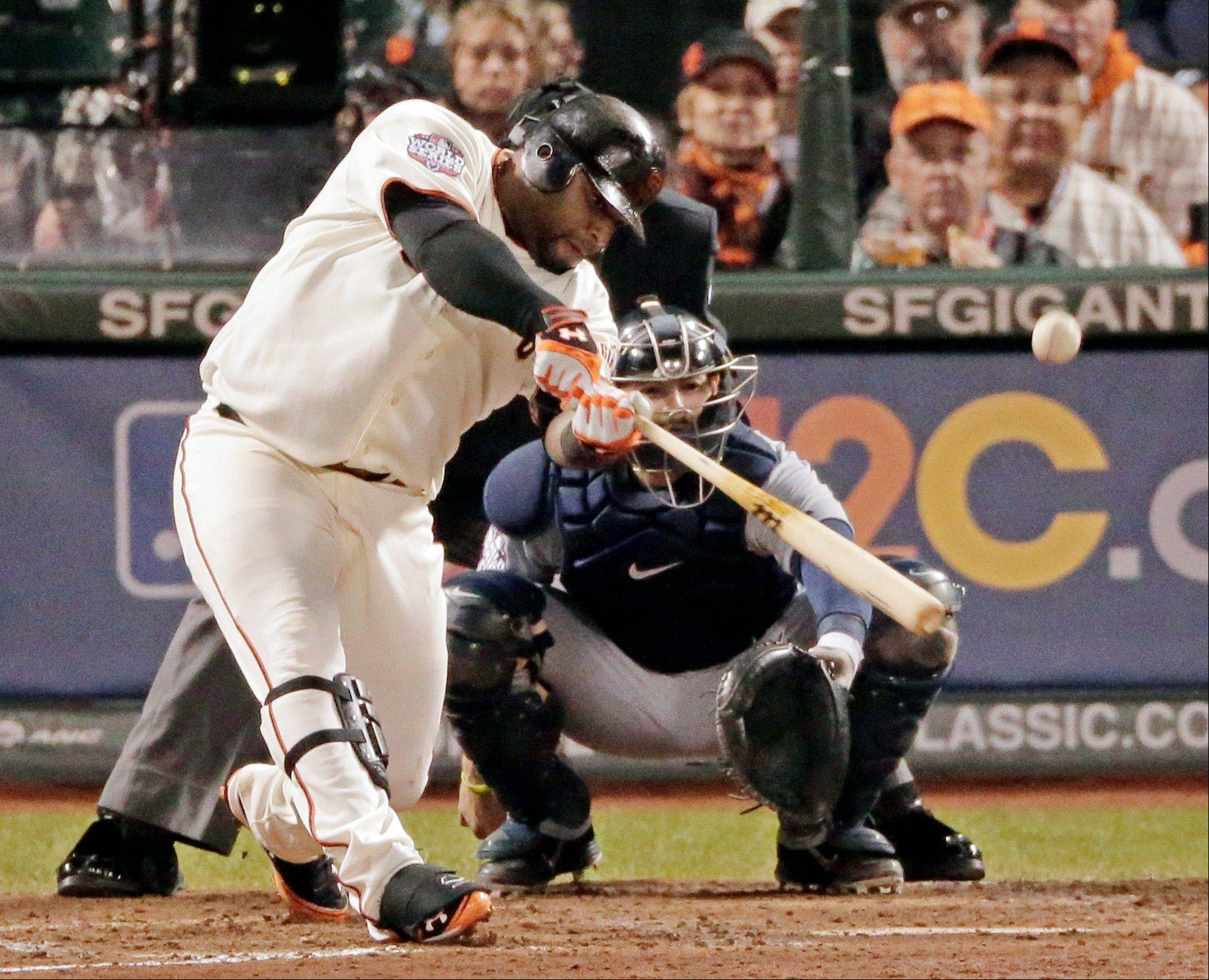 San Francisco Giants third baseman Pablo Sandoval hits a solo home run Wednesday during the sixth inning of Game 1 the World Series in San Francisco. The Giants beat the Detroit Tigers 8-3.