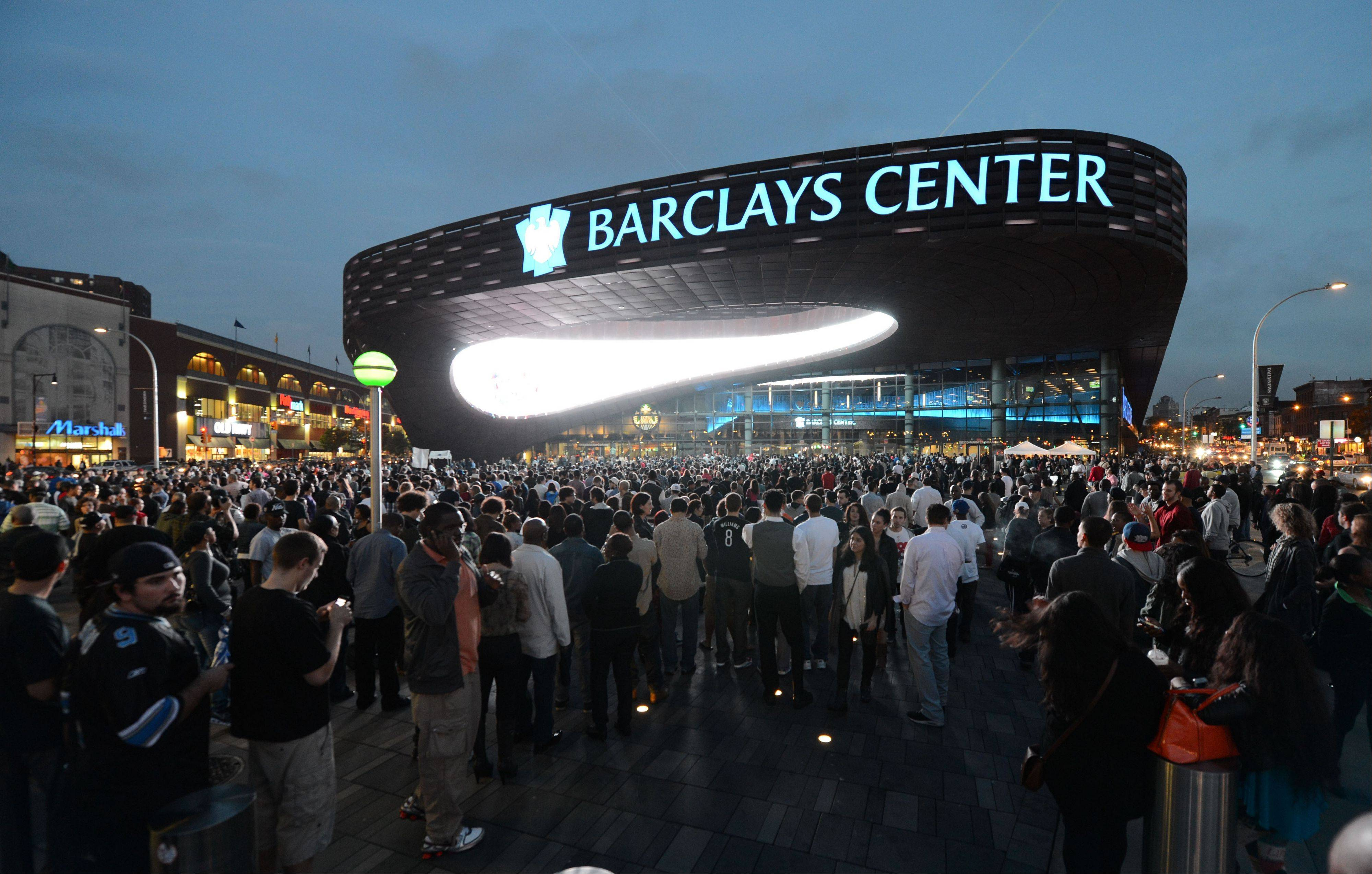 People arrive for the first of eight Jay-Z shows at the Barclays Center in Brooklyn. The New York Islanders have struck a deal to move to Barclays Center starting with the 2015-16 season.