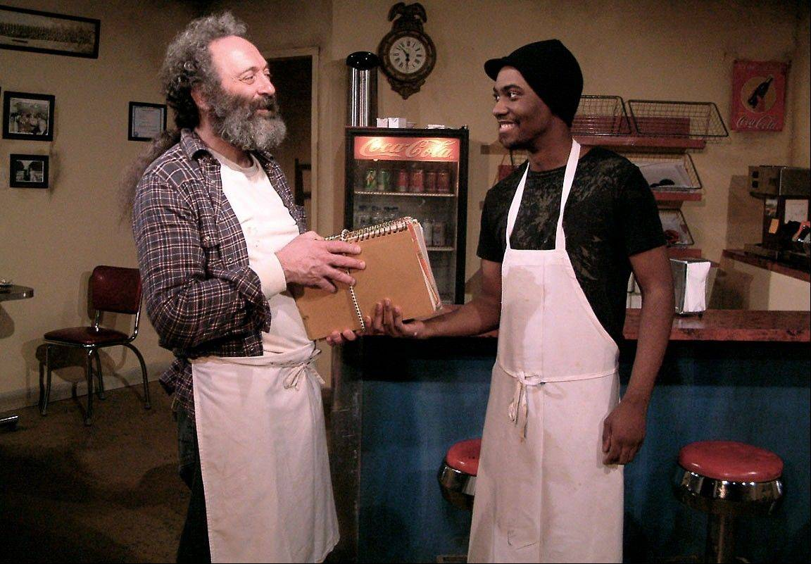 The owner of a failing doughnut shop (Richard Cotovsky, left) hires aspiring writer Franco Wicks (Preston Tate Jr.) in Mary-Arrchie Theatre�s remount of its hit production of Tracy Letts� �Superior Donuts� at Chicago�s Royal George Cabaret Theatre.