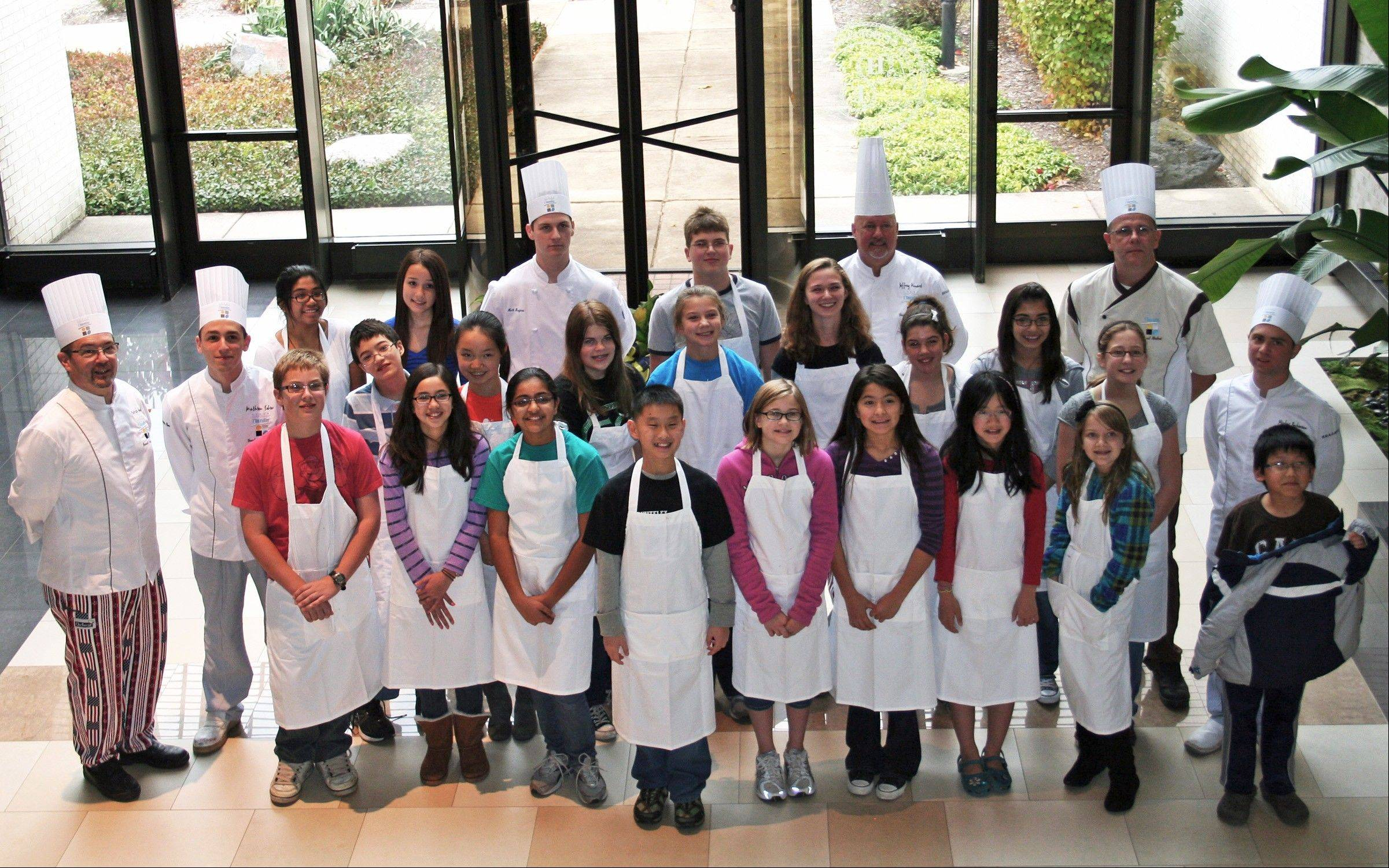 Chef Patrick Guat, far left, and his culinary students pose with participants in 2011�s children�s cooking class in the village hall lobby.