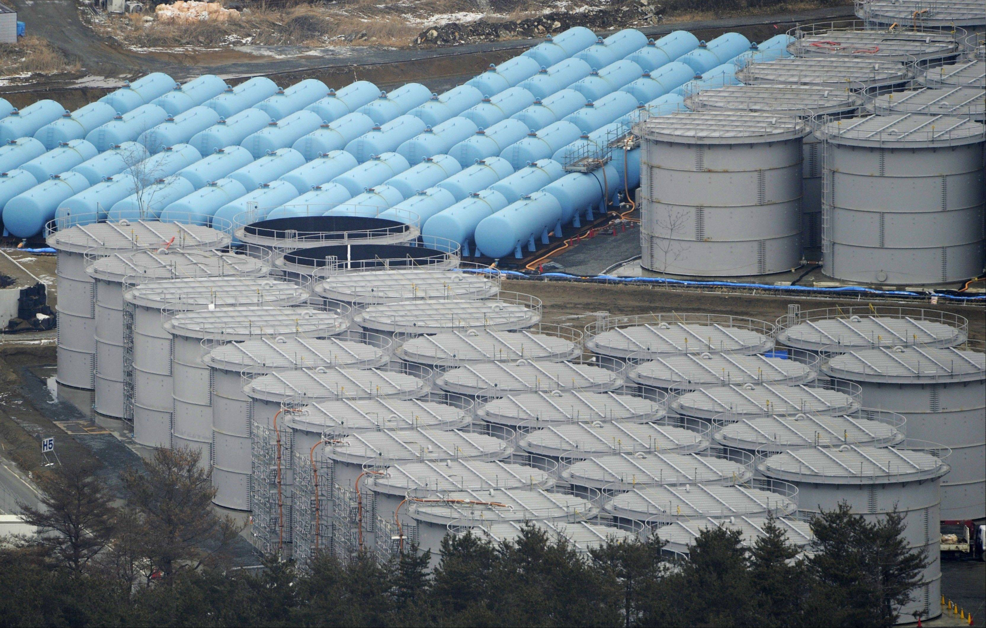 In this March 2012 file photo, storage tanks for radiation-contaminated water are seen in the compound of the tsunami-crippled Fukushima Dai-ichi nuclear power plant in northeastern Japan. Japan�s crippled nuclear power plant is struggling to find space to store tens of thousands of tons of highly contaminated water used to cool the broken reactors.