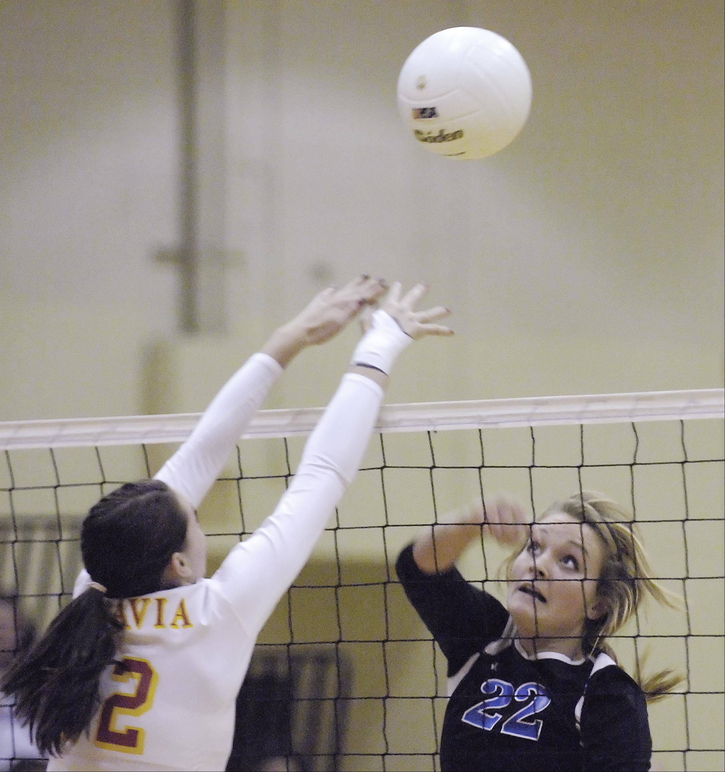Geneva�s Maddie Courter gets a shot past Batavia�s Shea Thayer Thursday in the regional championship.