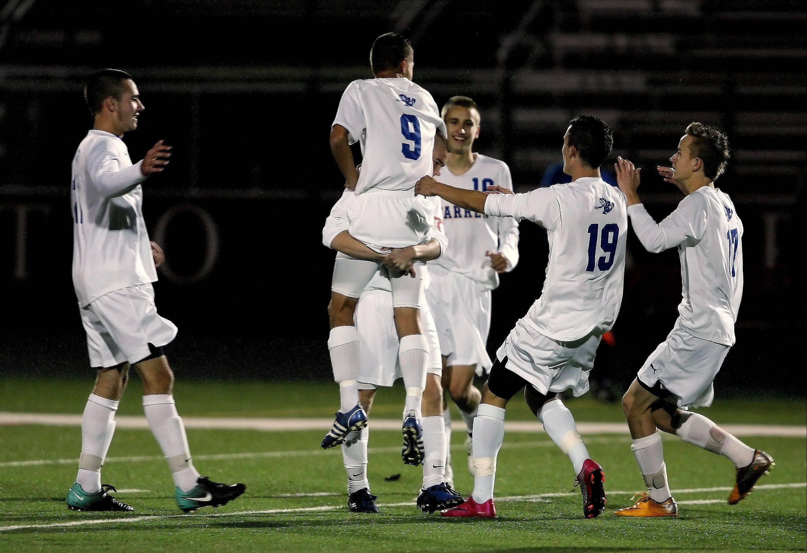Warren teammates celebrate after Daniel Szczepanek scored during last season�s supersectional game against Schaumburg at Barrington. The Blue Devils are one win away from returning to the supersectional round after another standout season from Szczepanek, the Daily Herald�s all-area team captain.