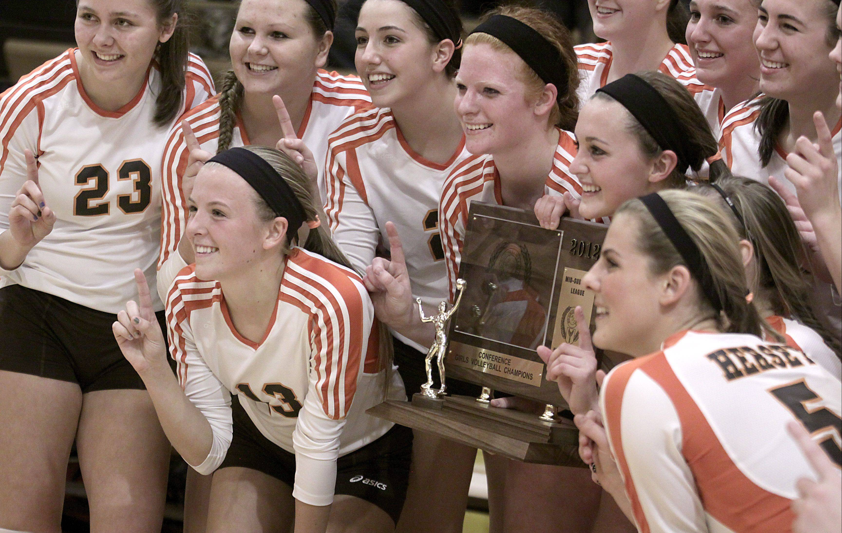 Hersey, with Abby Fesl and Taylor Schill holding the MSL championship trophy, pose with teamates after earning the program�s 10th league title.