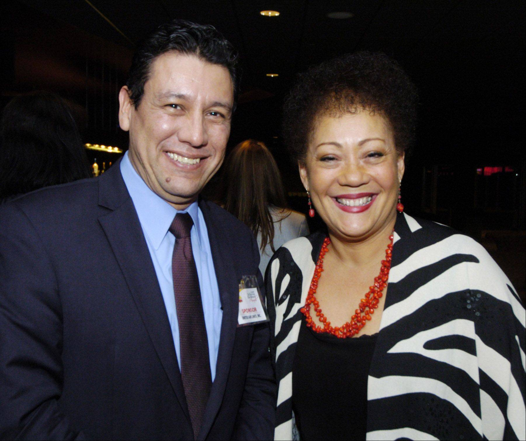 Francisco Figueroa, account manager for Latin America and Caribbean sales for United Airlines, stands beside guest speaker Dr. Lourdes Ferrer during the Reflejos Reflecting Excellence Awards Wednesday at the Sears Centre in Hoffman Estates.