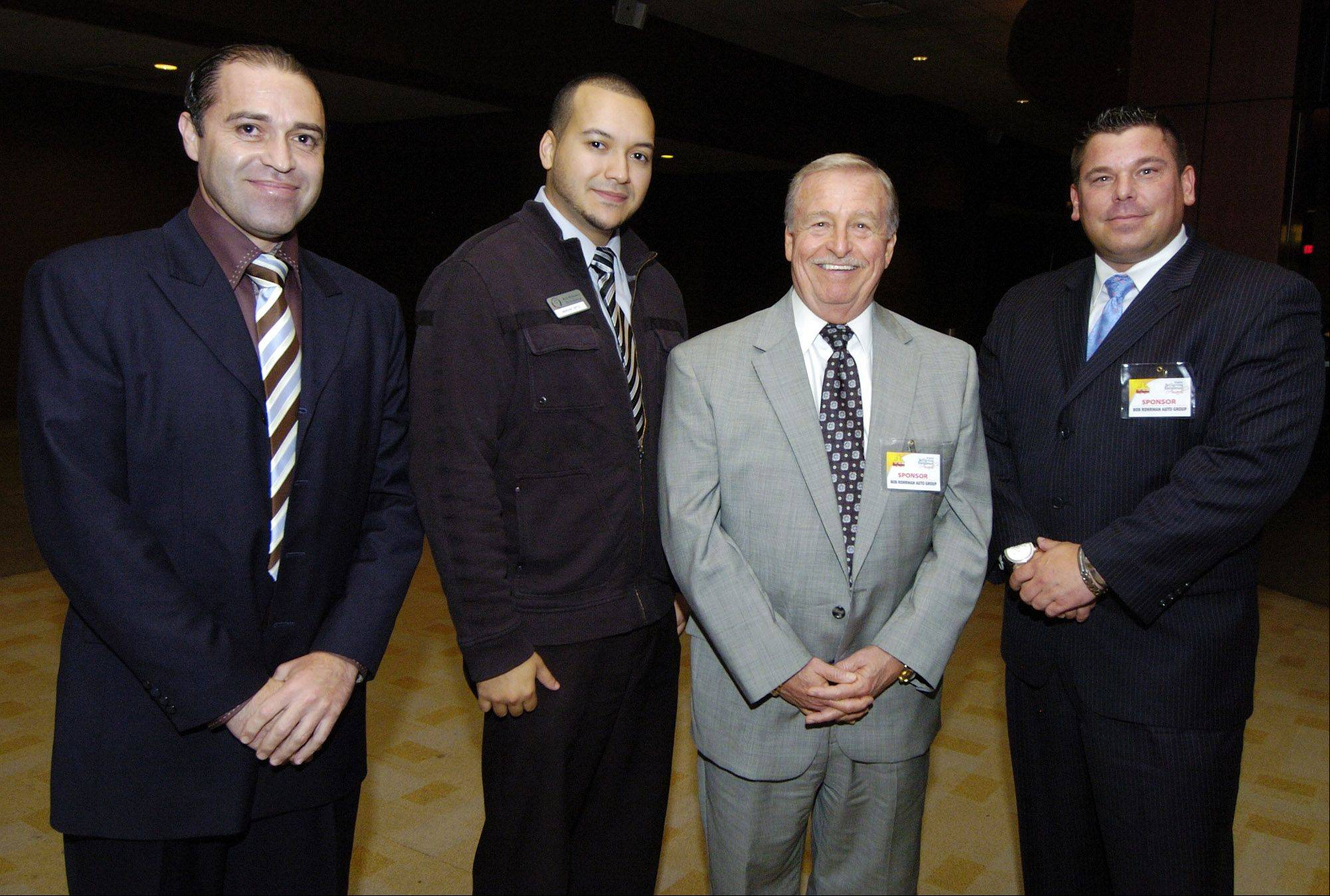Alex Castro of Arlington Lexus in Palatine and Marvin Ortiz, John Barrett and Kurt Blankenburg, all of Bob Rohrman Schaumburg Kia, attended the Reflejos Reflecting Excellence Awards at the Sears Centre in Hoffman Estates.