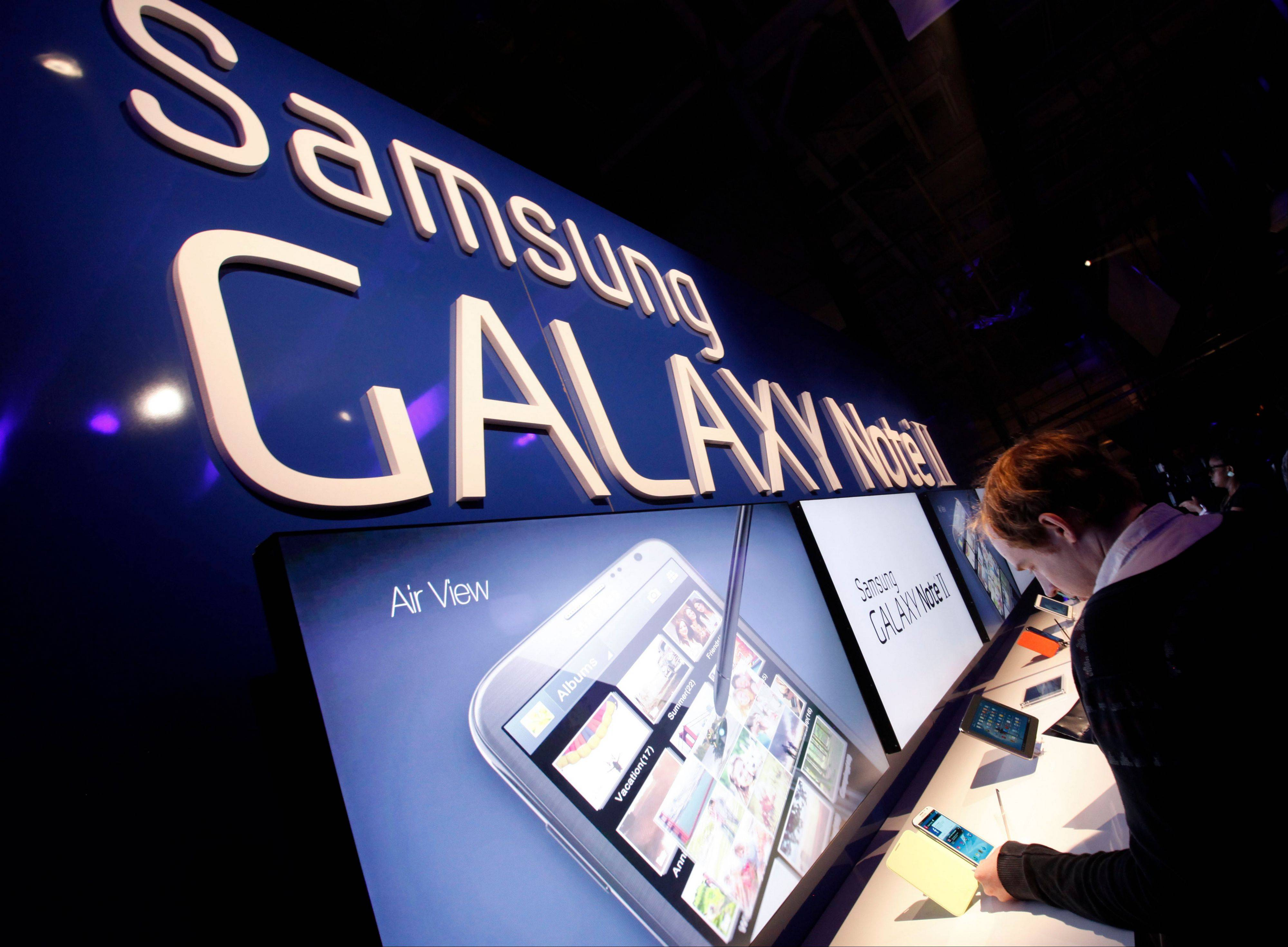 Attendees try out the new Samsung Galaxy Note II during a launch event, Wednesday in New York.