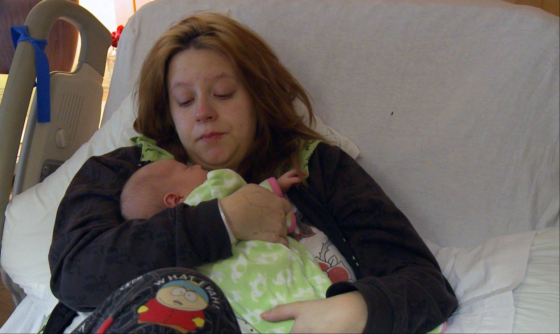 "Genavieve Diggs and her baby, who will be adopted by gay parents Mark Krieger and Paul Siebold, in ""The Baby Wait,"" a six-part documentary series on the Logo channel that focuses equal attention on agonizing post-birth waiting periods from the perspectives of both biological and adoptive parents."