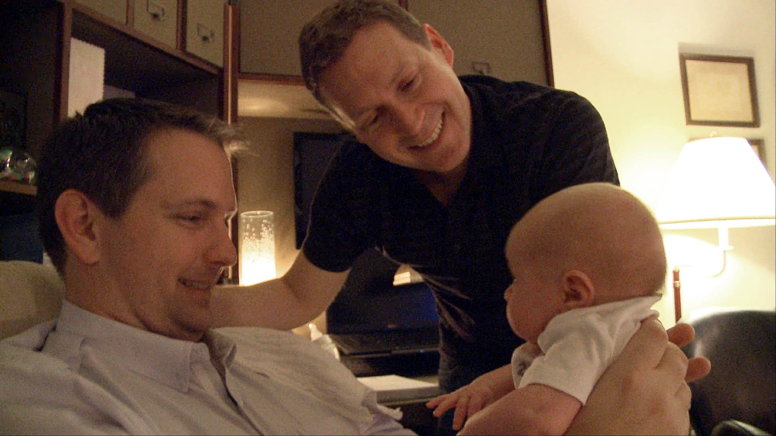 "Adoptive parents Mark Krieger, left, and Paul Siebold hold their new baby girl in ""The Baby Wait,"" a six-part documentary series on the Logo channel that focuses equal attention on agonizing post-birth waiting periods from the perspectives of both biological and adoptive parents."