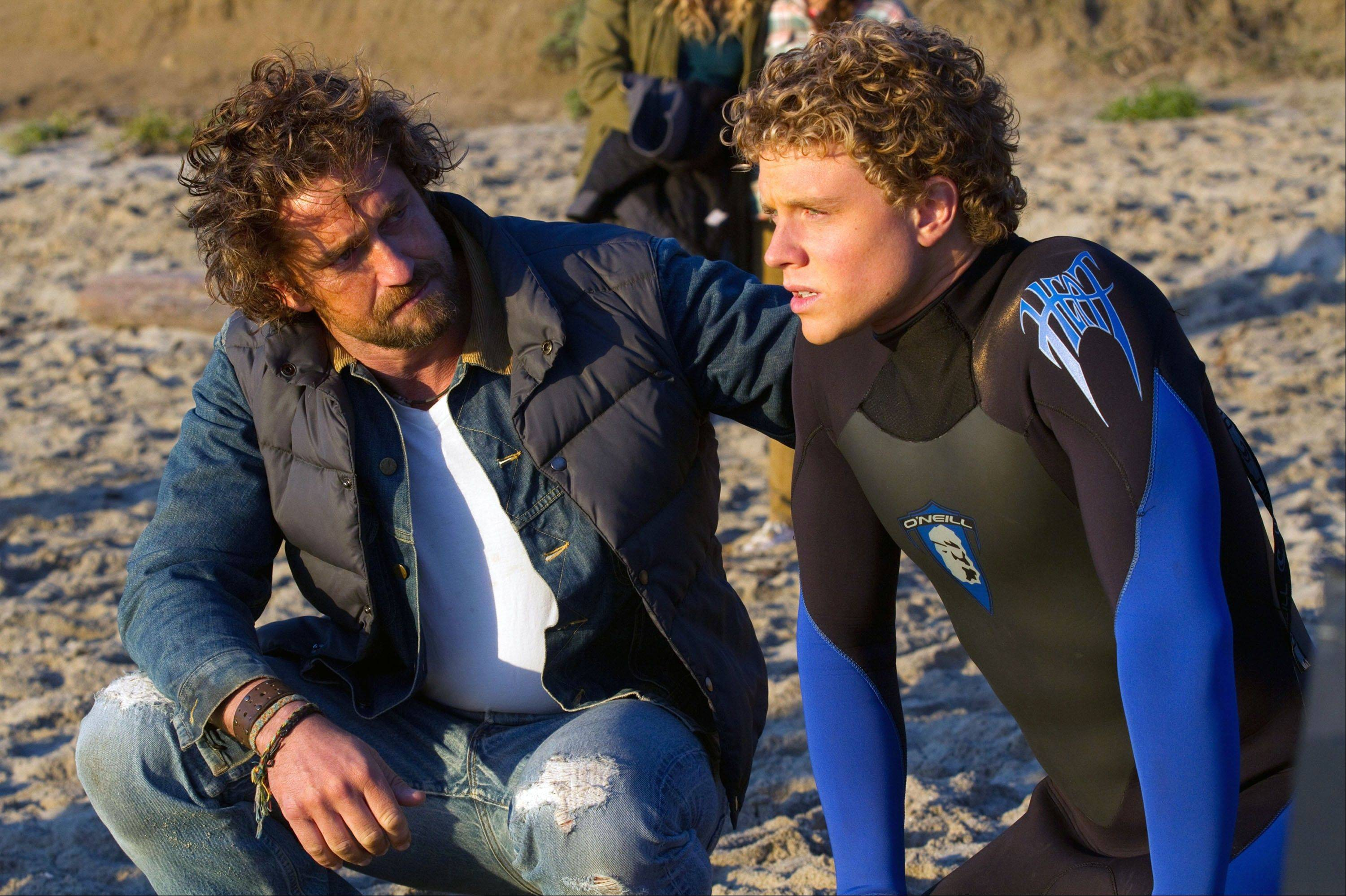 "Veteran surfer Frosty (Gerard Butler) trains a troubled teenager (Jonny Weston) to challenge a legendary monster wave in ""Chasing Mavericks."""