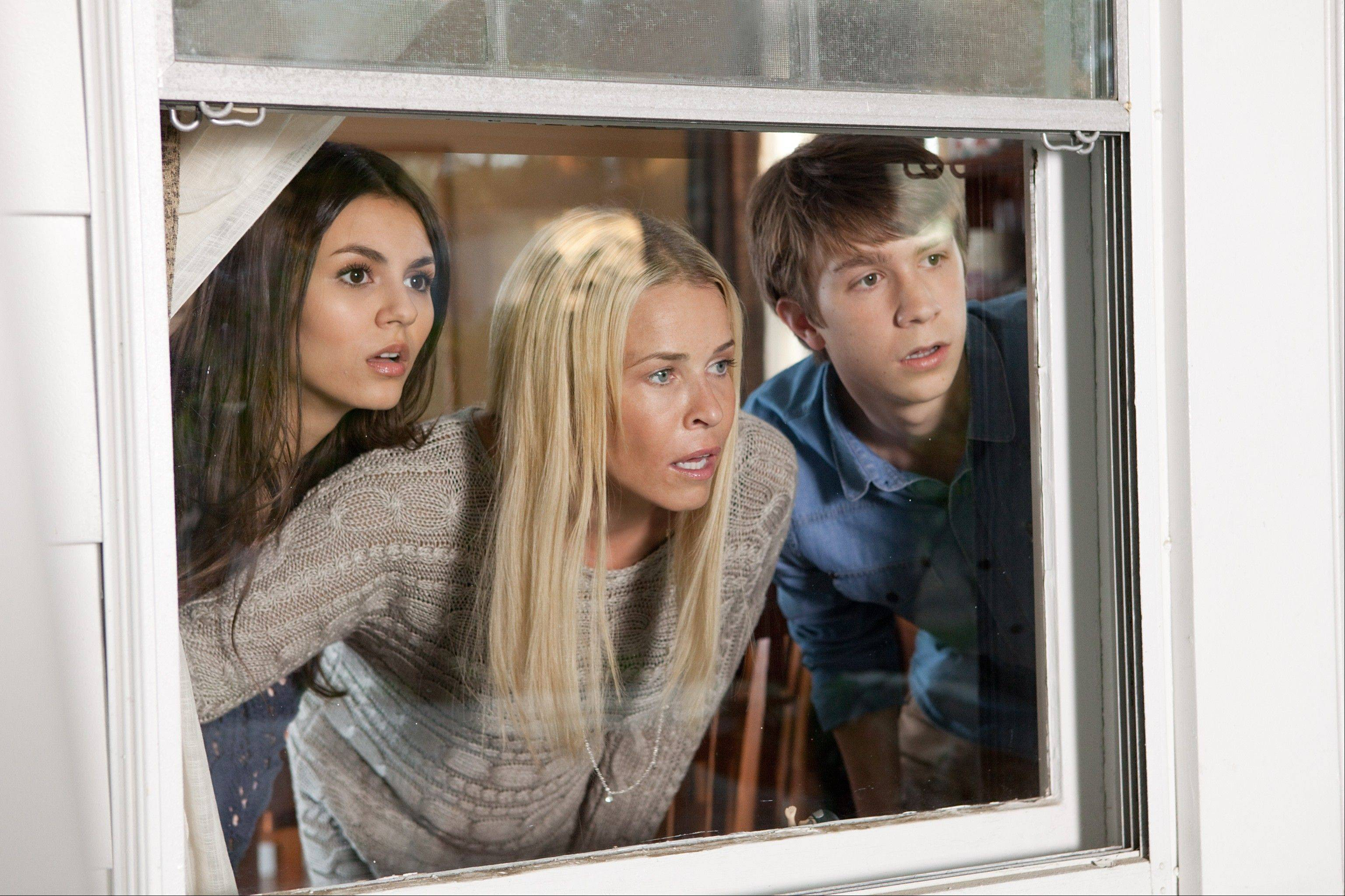 "Wren (Victoria Justice), left, her mom (Chelsea Handler) and Roosevelt (Thomas Mann) can't believe the crassness they're witnessing in Nickelodeon's tweener comedy ""Fun Size."""