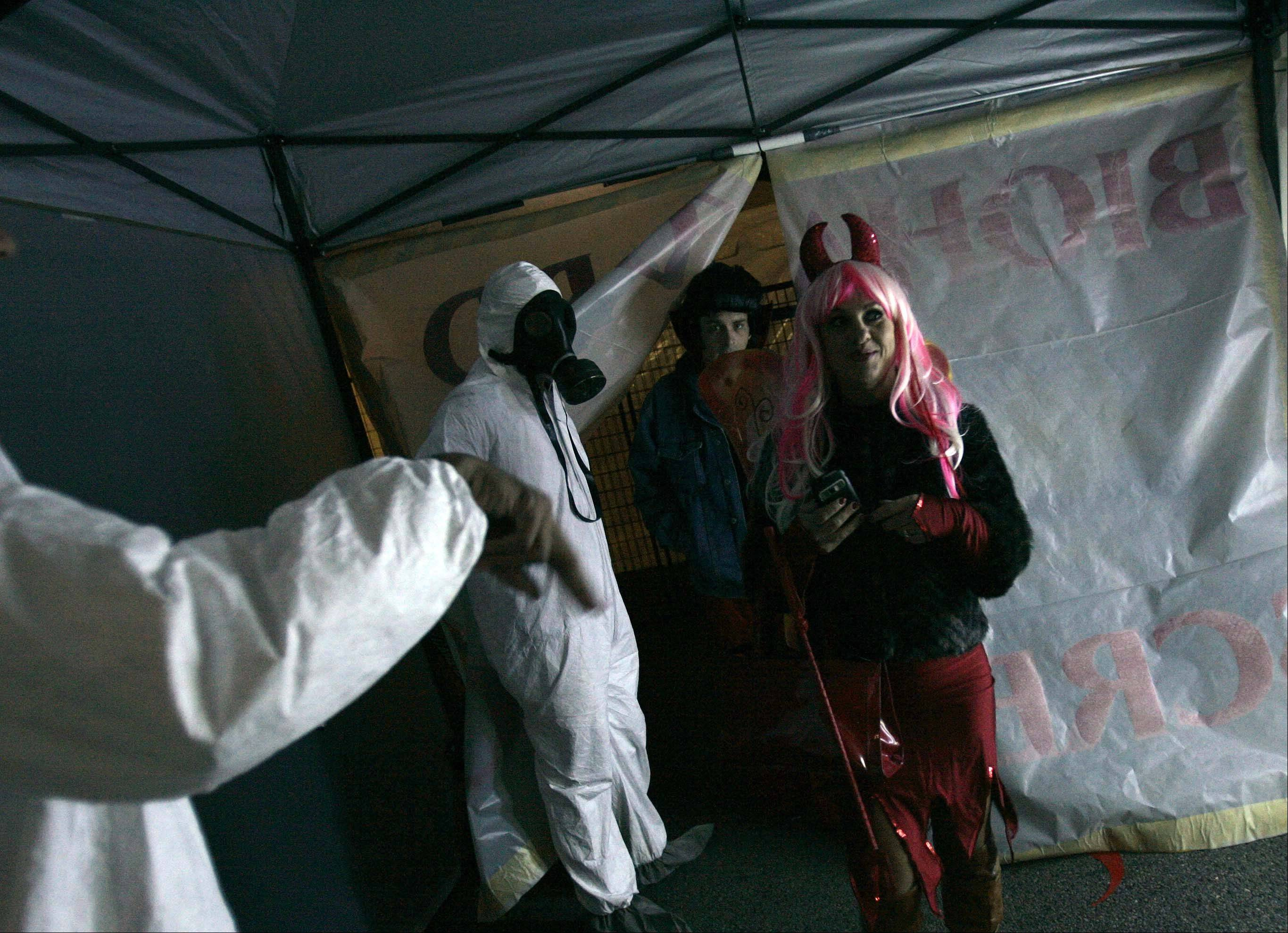 Donna and Rob Wilhelm of Algonquin make their way through the decontamination station Saturday night.