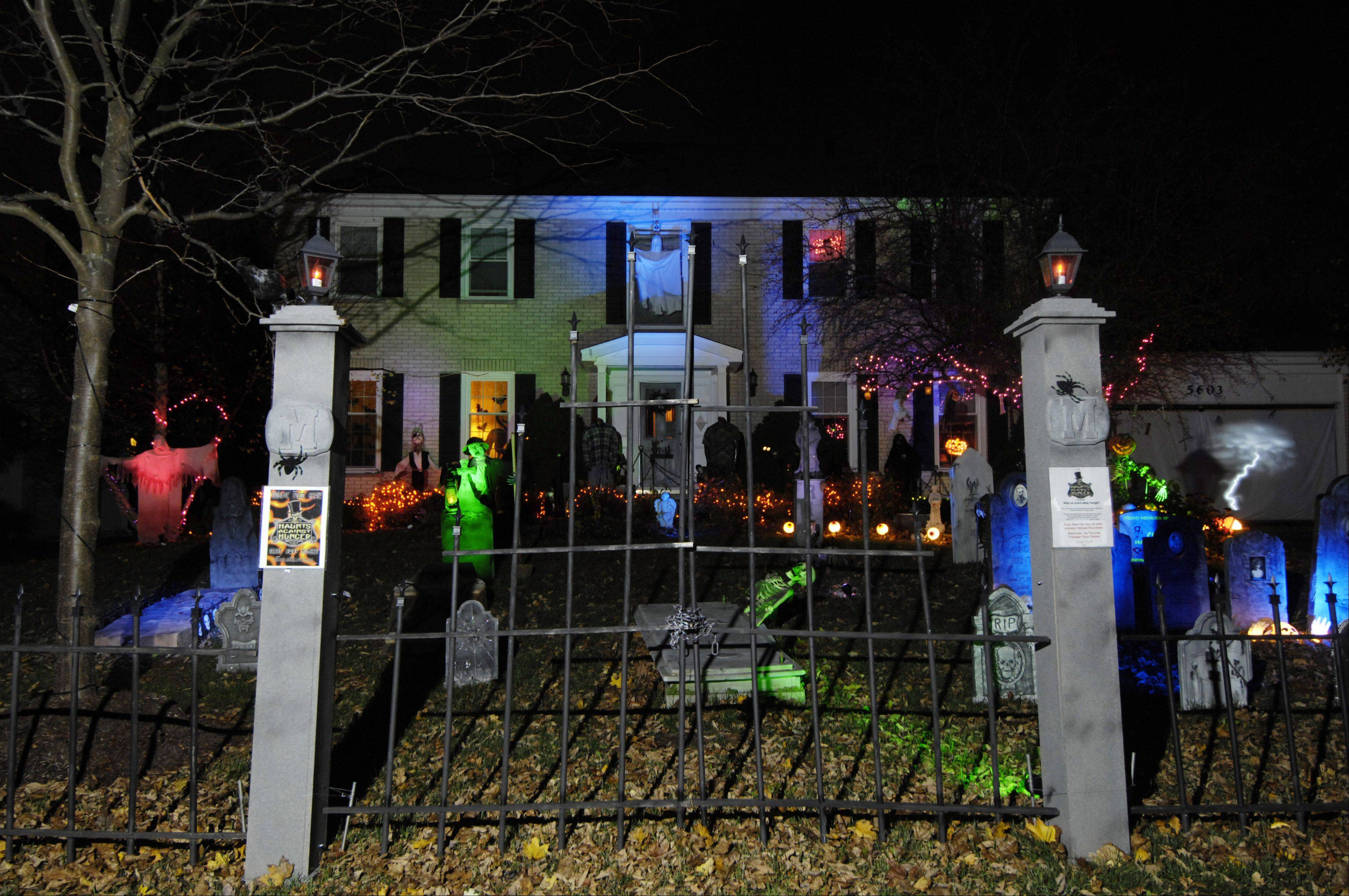 Michael Kravchuk asks the hundreds of people who come by his home to see his Halloween graveyard to donate a nonperishable food item to the Palatine Food Pantry.