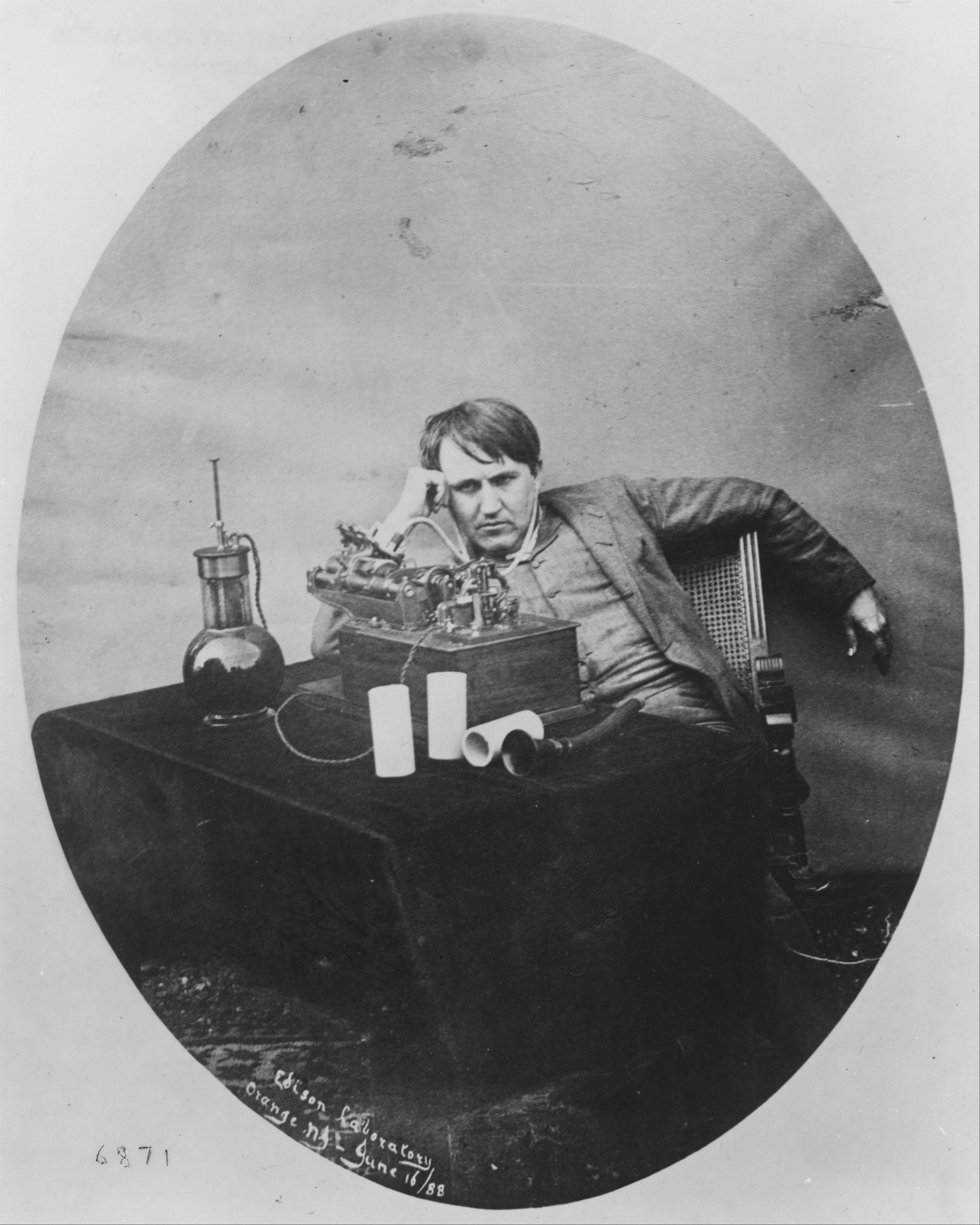 This 1888 photo provided by the Museum of Innovation and Science in Schenectady, N.Y., shows Thomas Edison listening to a wax cylinder phonograph.