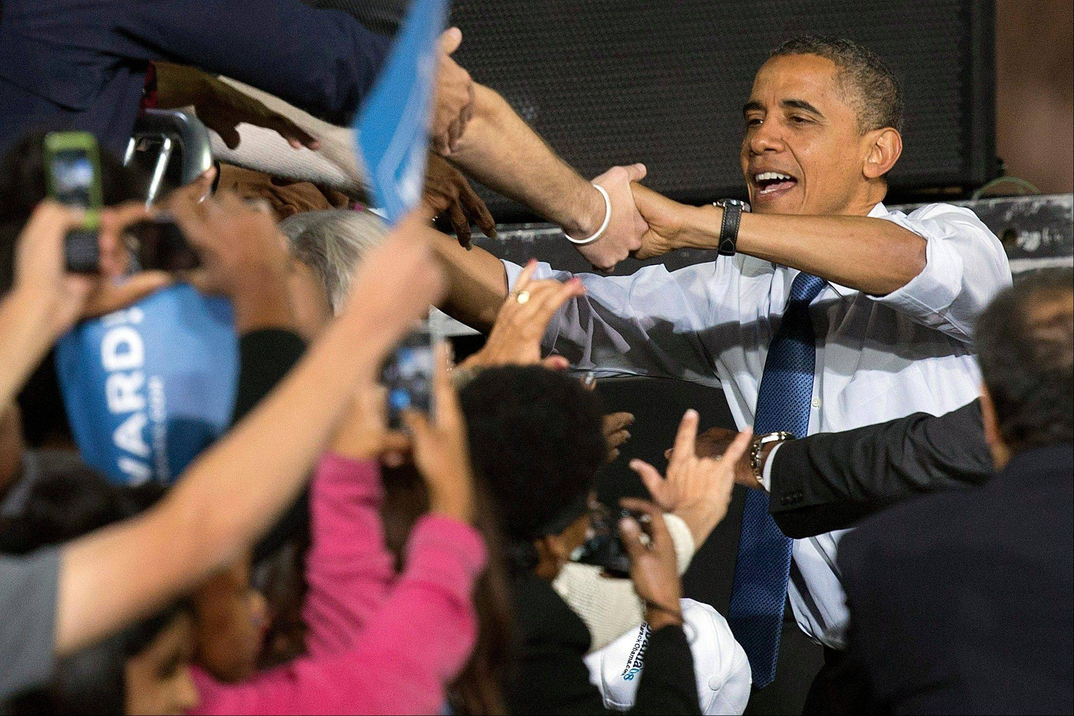 President Barack Obama greets supporters after speaking at a campaign rally, Wednesday, Oct. 24, 2012, in Las Vegas. The president is on a two-day tour of key battleground states that included stops in Iowa and Colorado on Wednesday and was scheduled to head to Florida, Virginia and Ohio on Thursday.