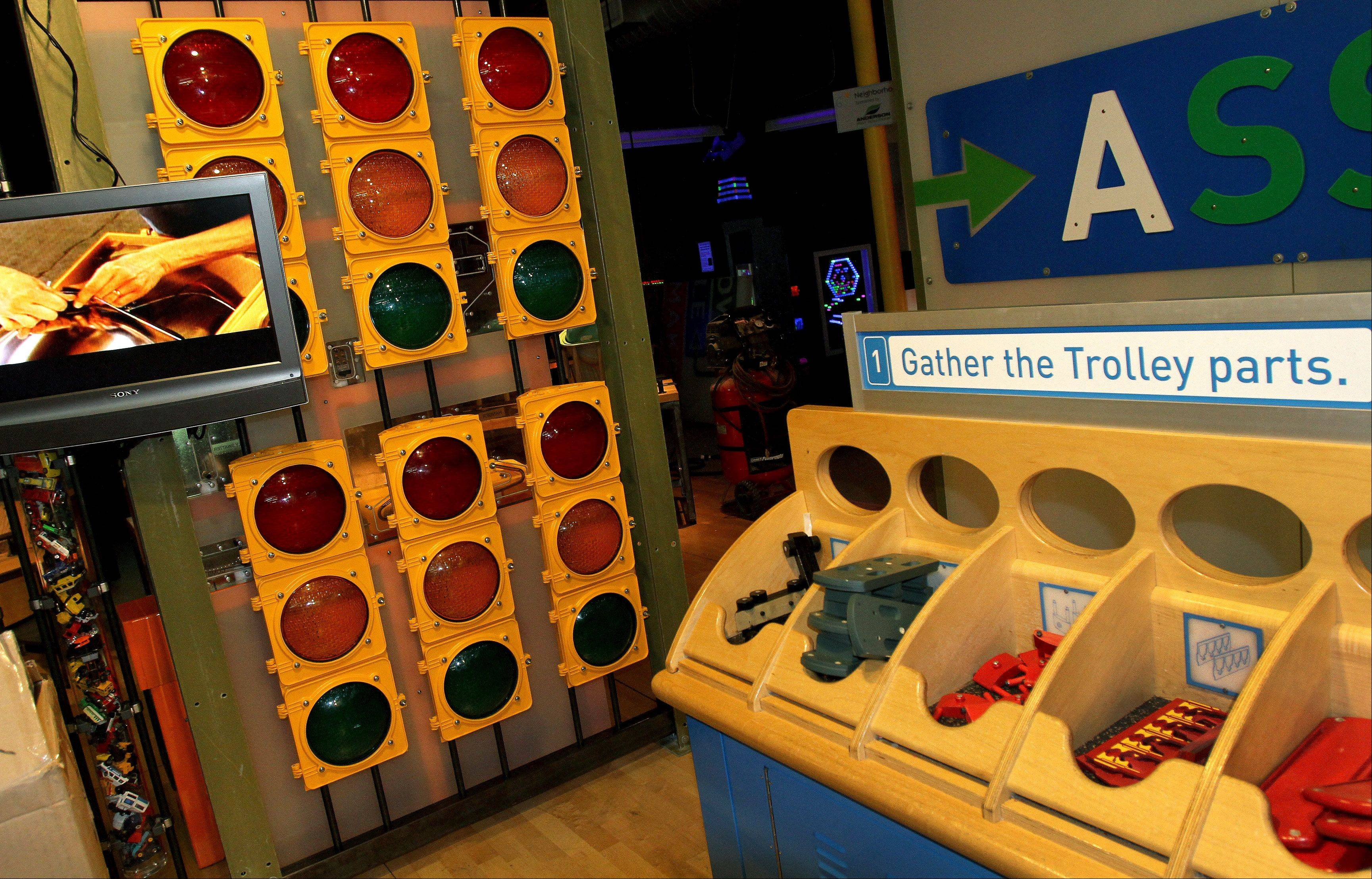 "Visitors can see how stop lights are made and put together a trolley in How People Make Things, a new exhibit at the DuPage Children's Museum. The exhibit is inspired by segments on ""Mr. Rogers' Neighborhood."""