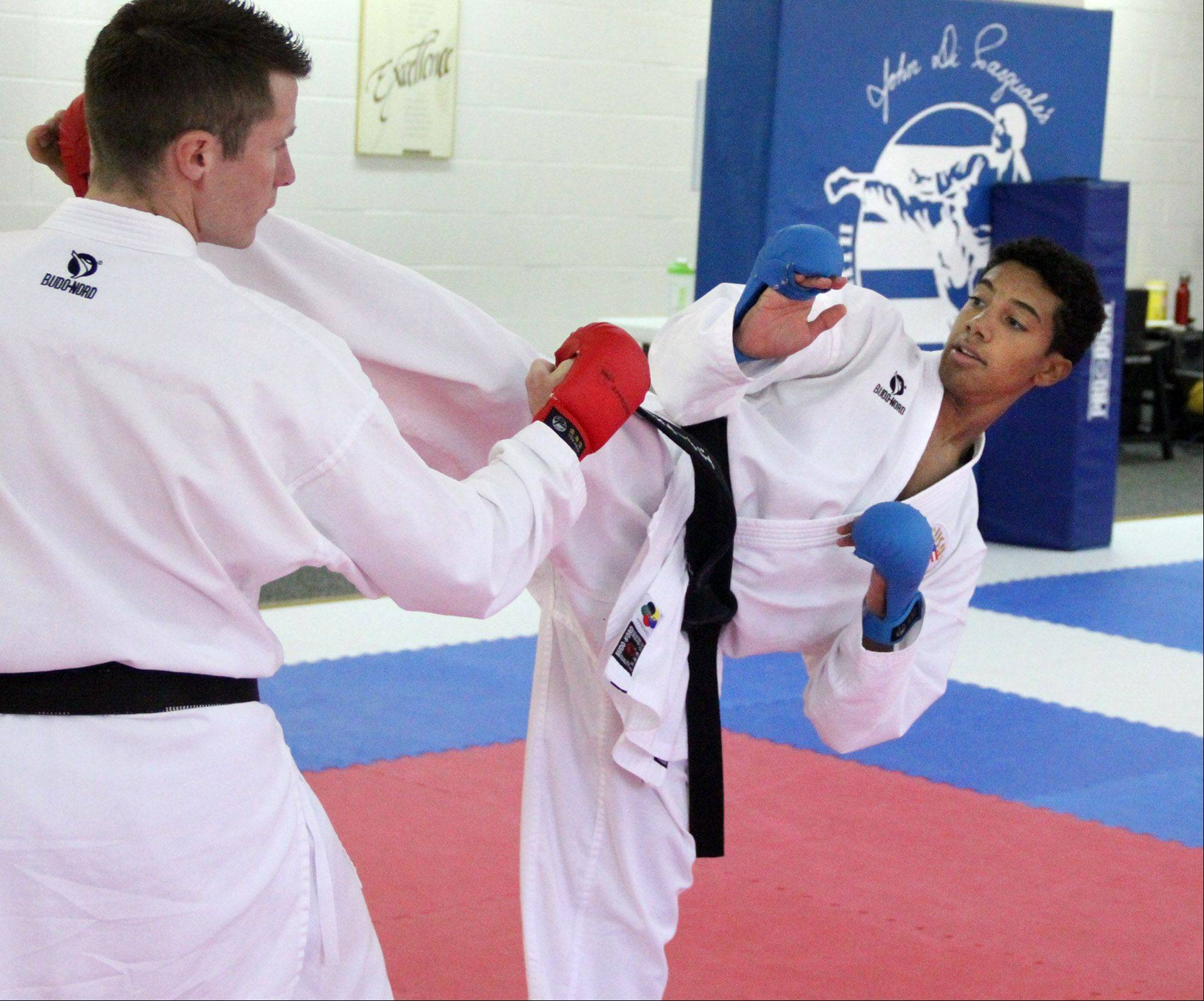 Brandon Malone, right, trains with karate instructor and U.S. team coach Brian Mertel at the Illinois Shotokan Karate Clubs dojo in Palatine.