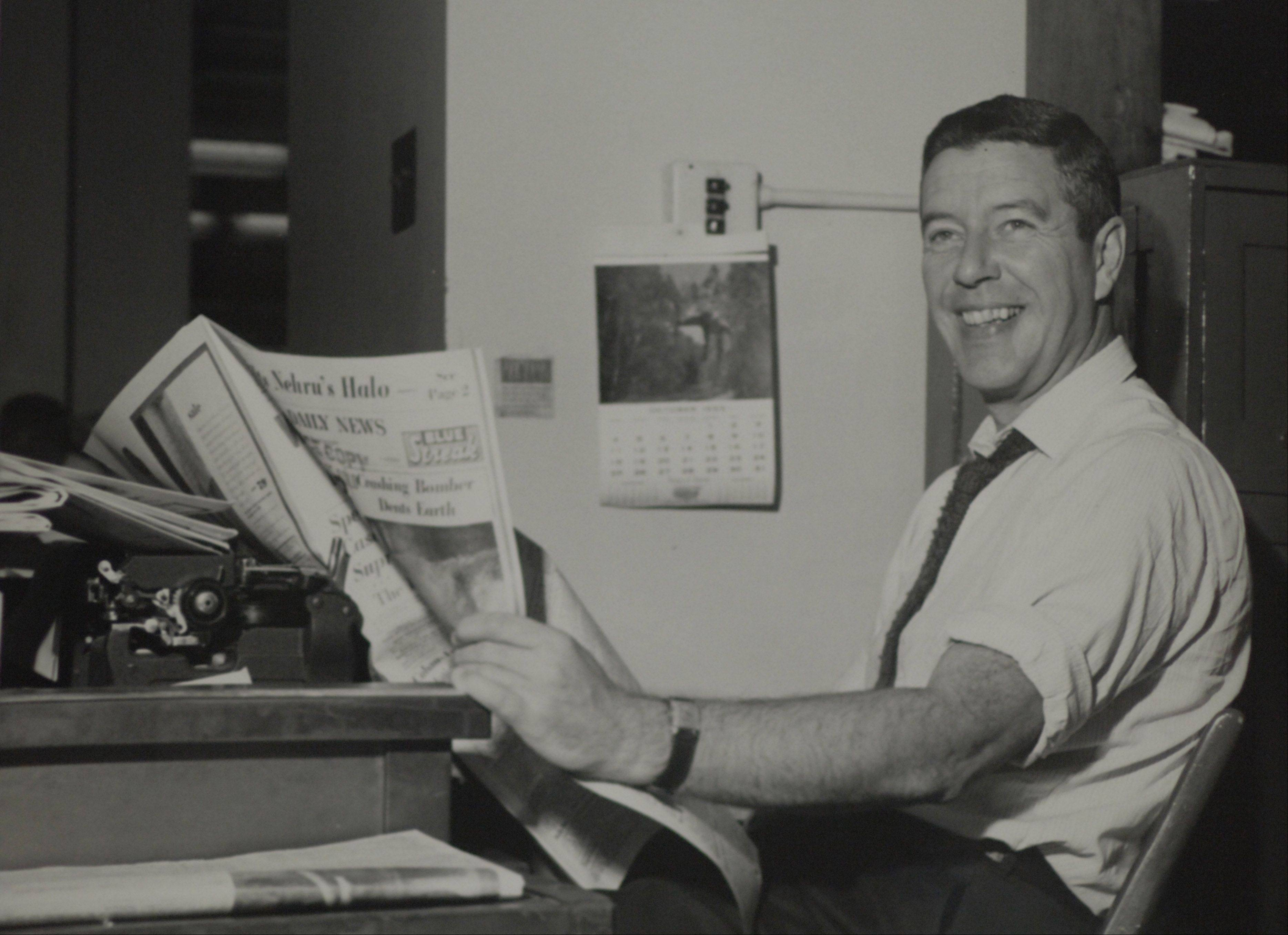 Shown here holding a copy of the Chicago Daily News, columnist Jack Mabley wrote so many important stories that his work has been included in a 125th anniversary exhibit at Chicago's famed Newberry library.