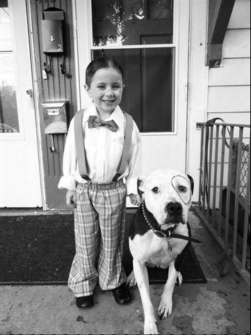 Kingston, my American pit bull terrier, and my son, dressed as Our Gang members.