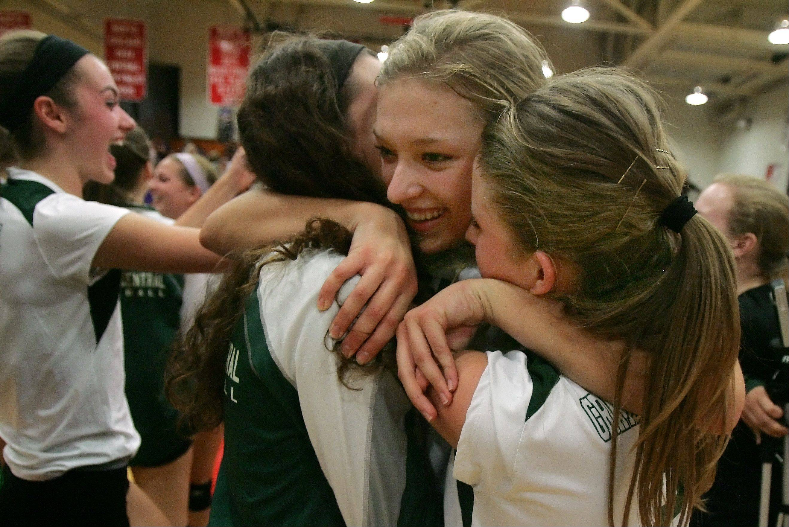 Grayslake Central's Lexi Beckman, center, hugs teammate Anna Basten, left, and Anna Strickland after the Rams won the Class 3A girls regional final against Wauconda at North Chicago.