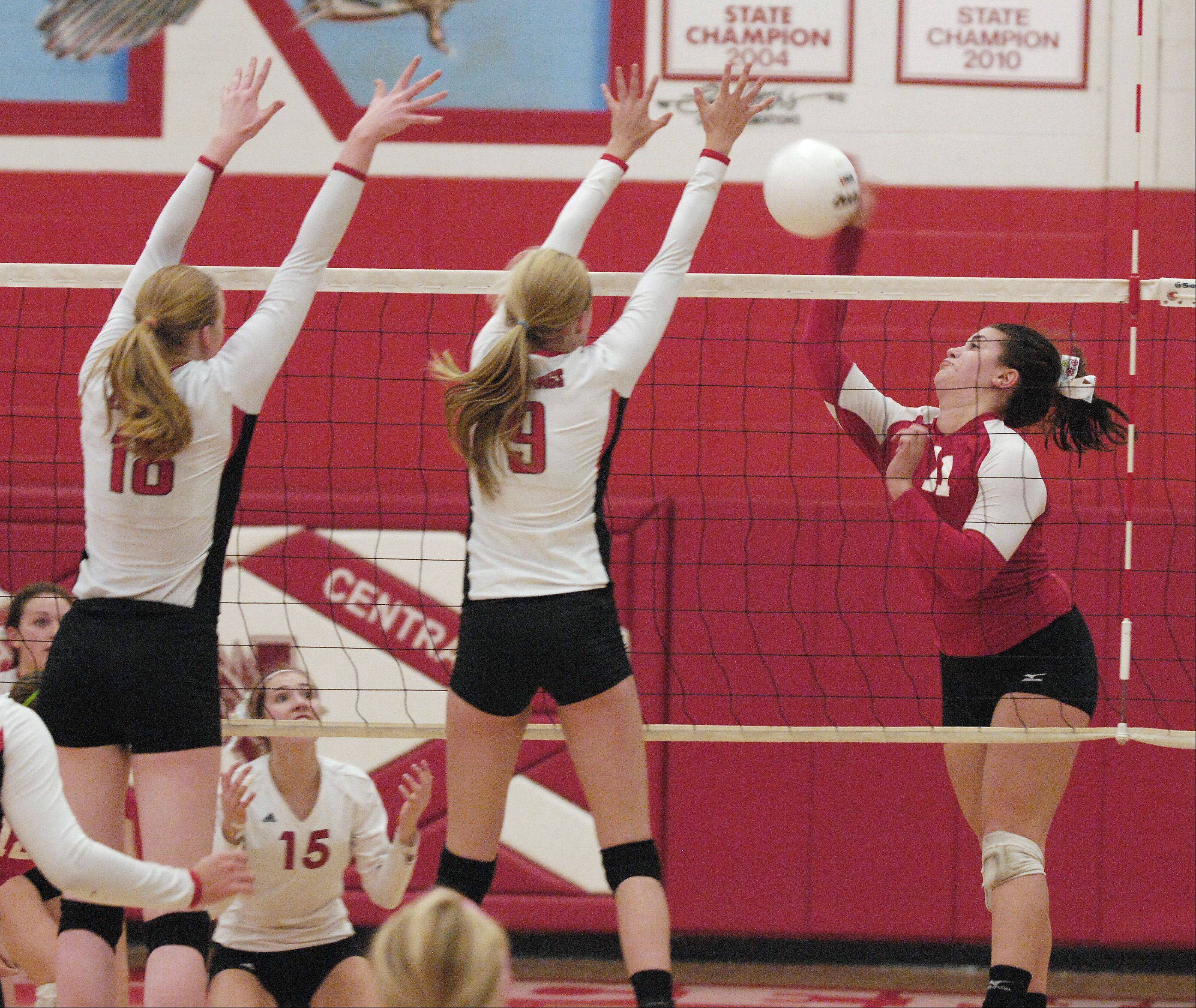 Rachael Fara and Abby Willett of Benet Academy attempt to block as shot by Maddie Siambekos of Naperville Central during the Redwings 2-0 win of the girls Class 4A regional final in Naperville, Thursday.