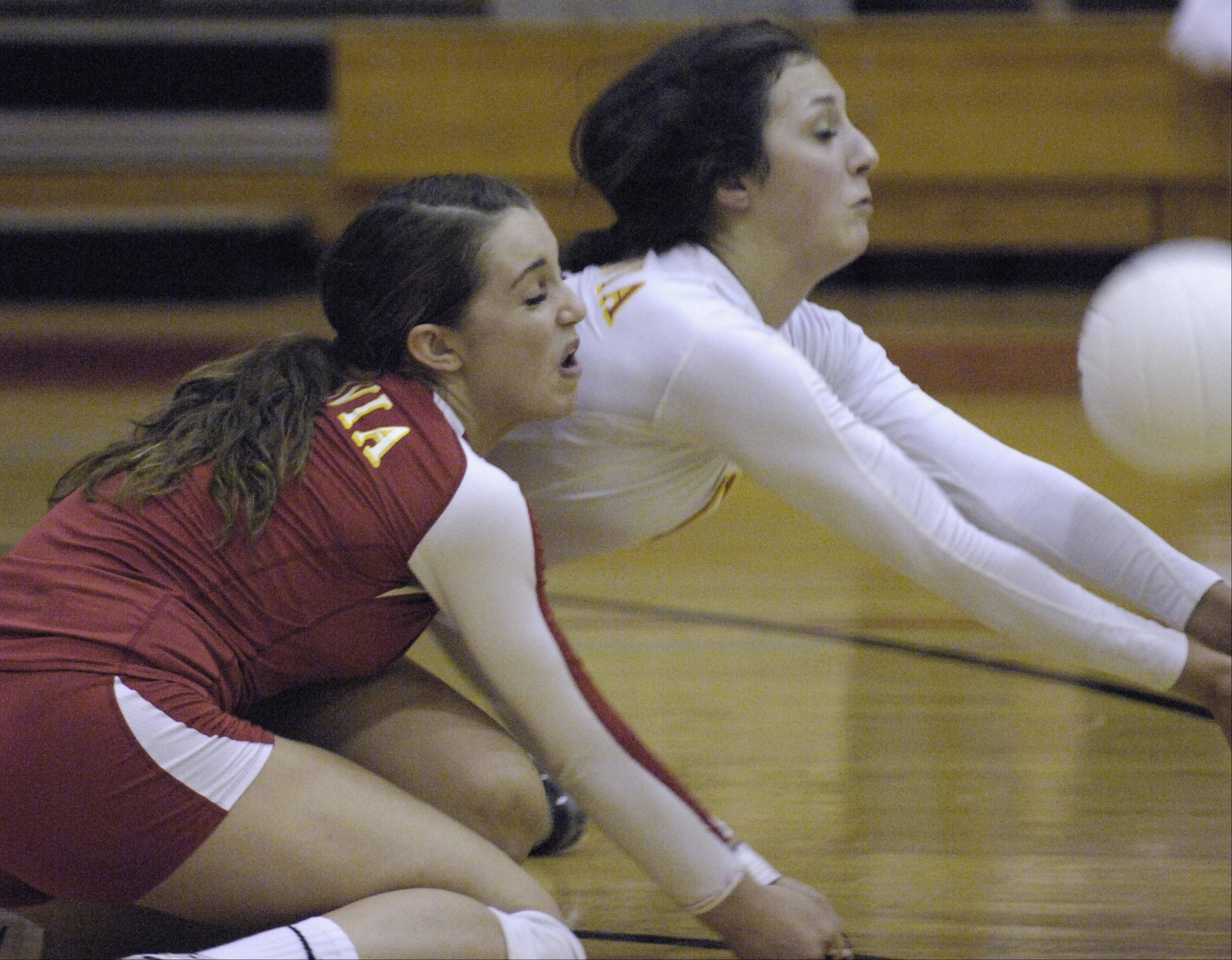 Batavia's Jessica Hartmann and Anysa Ocon, right, collide as they go for a dig against Geneva Thursday in the regional championship.