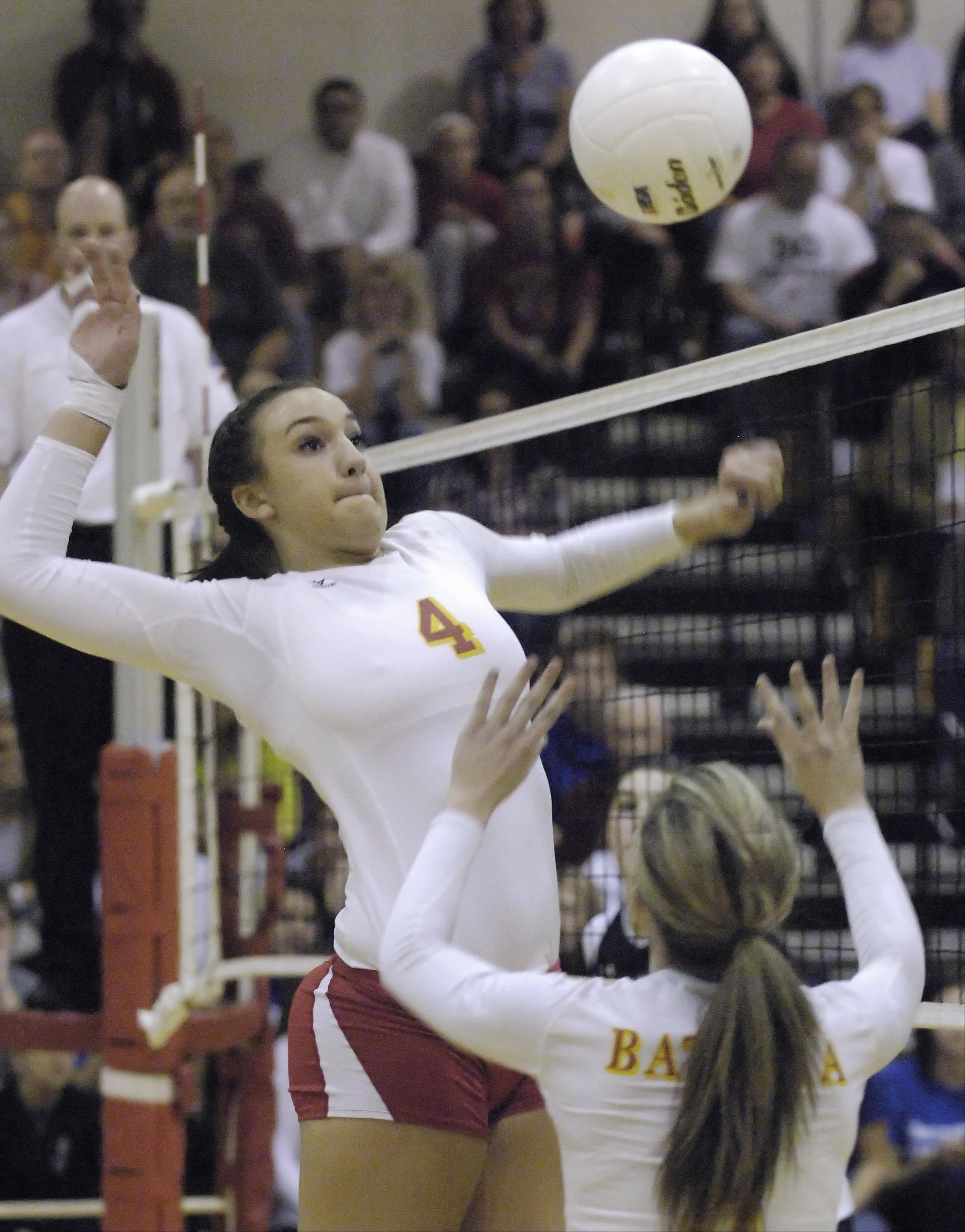 Batavia's Kristen Koncelik lines up a set by teammate Audrey Faulhaber against Geneva Thursday in the regional championship.