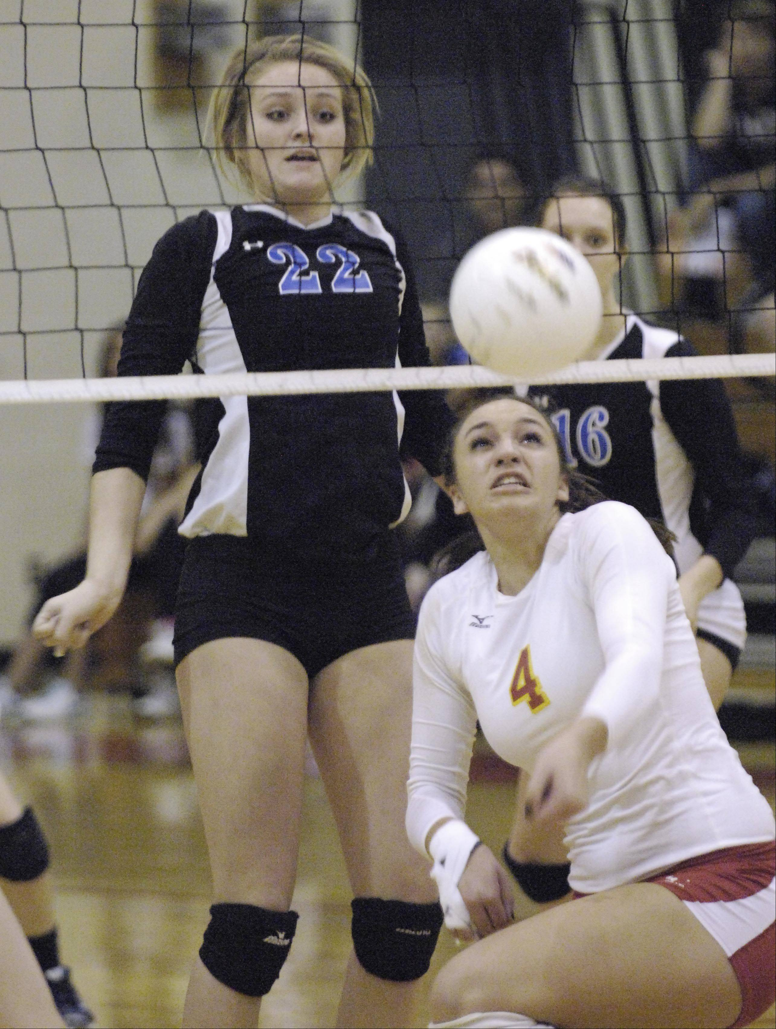 Batavia's Kristen Koncelik turns to bump the ball as Geneva's Maddie Courter watches her shot score Thursday in the regional championship.