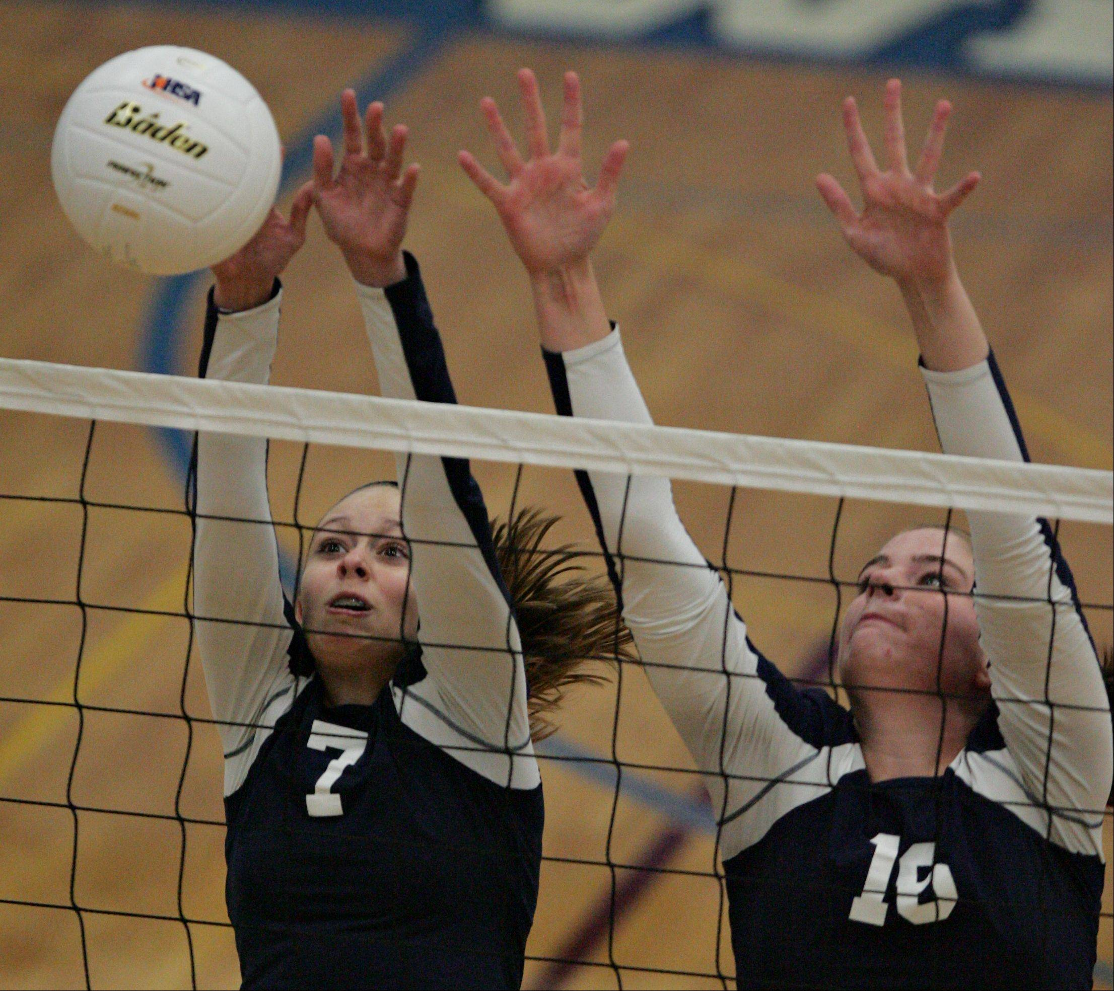Harvest Christian's Ellie Burzlaff, left, and Sarah Kott combine efforts on a block against Westminster Christian Thursday night in Elgin.