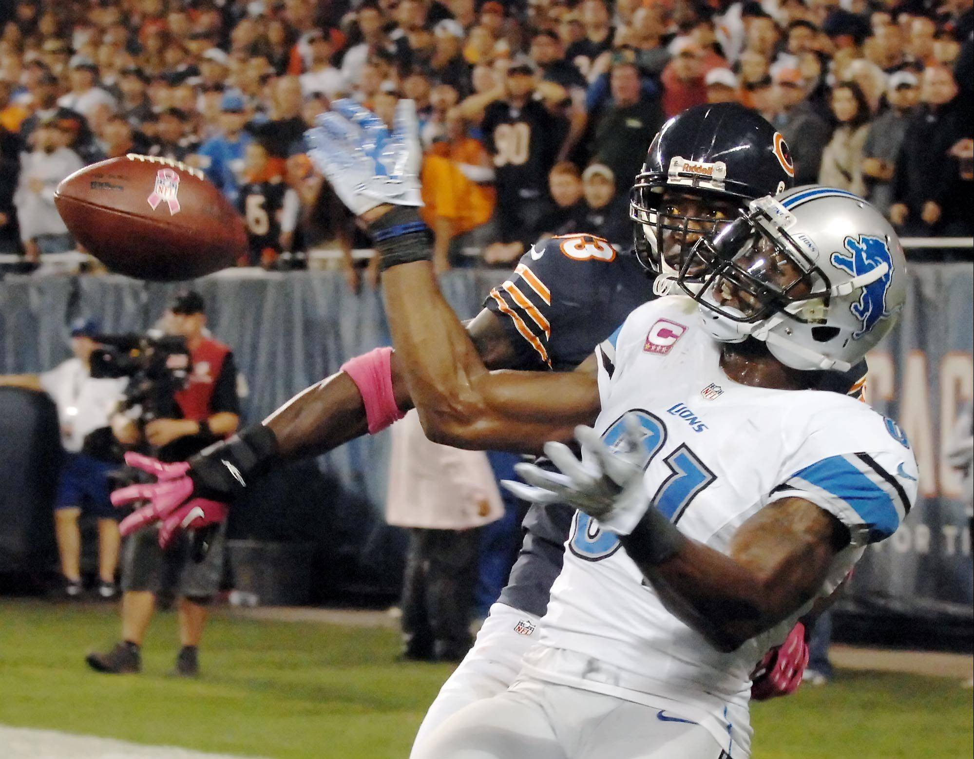 Cornerback Charles Tillman knocks the ball away from Lions wide receiver Calvin Johnson in the end zone late in the fourth quarter of the Bears' 13-7 win at Soldier Field on Monday night.