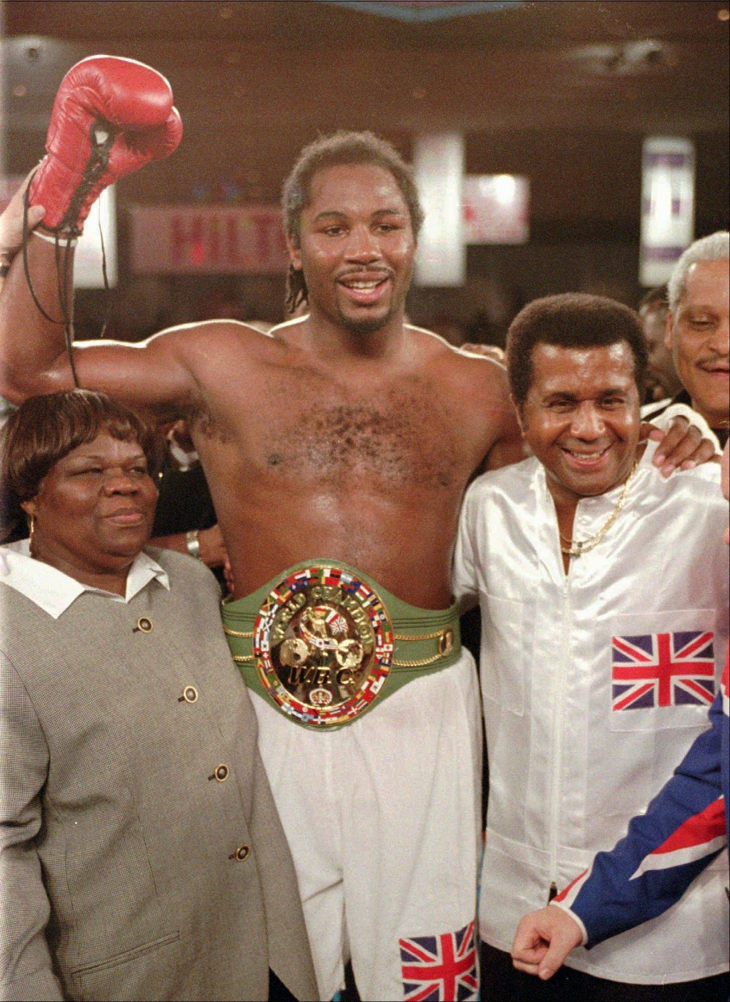 File-This Feb. 7, 1997 file photo shows newly crowned WBC heavyweight champion Lennox Lewis, center, reacting with his mother, left, and trainer Emanuel Steward after defeating Oliver McCall with a TKO in the fifth round at the Hilton Hotel in Las Vegas. teward, the owner of the legendary Kronk Gym and one of boxing's greatest trainers, has died. He was 68. Victoria Kirton, Steward's executive assistant, says Steward died Thursday Oct. 25, 2012 in a Chicago hospital. She did not disclose the cause of death.