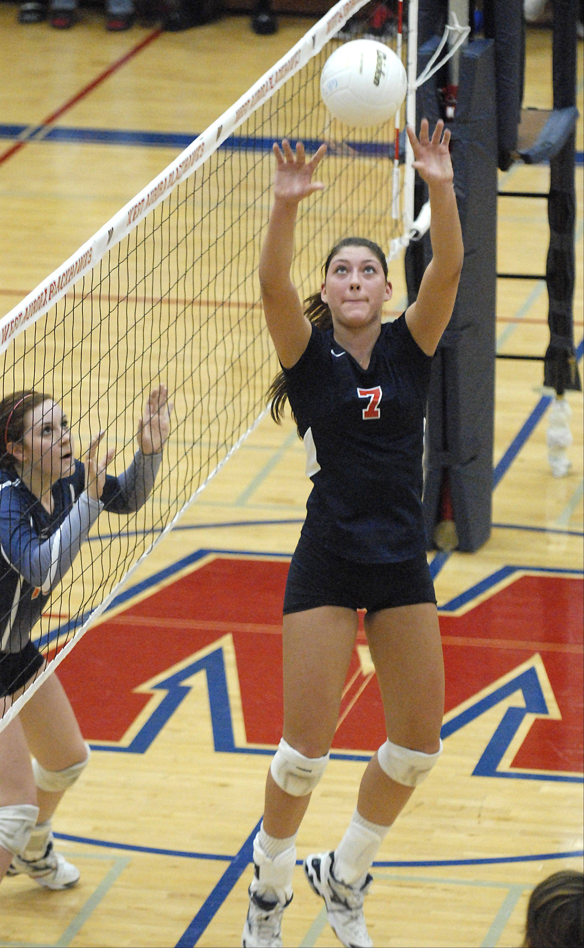 West Aurora's Lauren Carlini sets up a spike to be sent to Naperville North's Corinne Gajcak in the first game on Thursday, October 11.