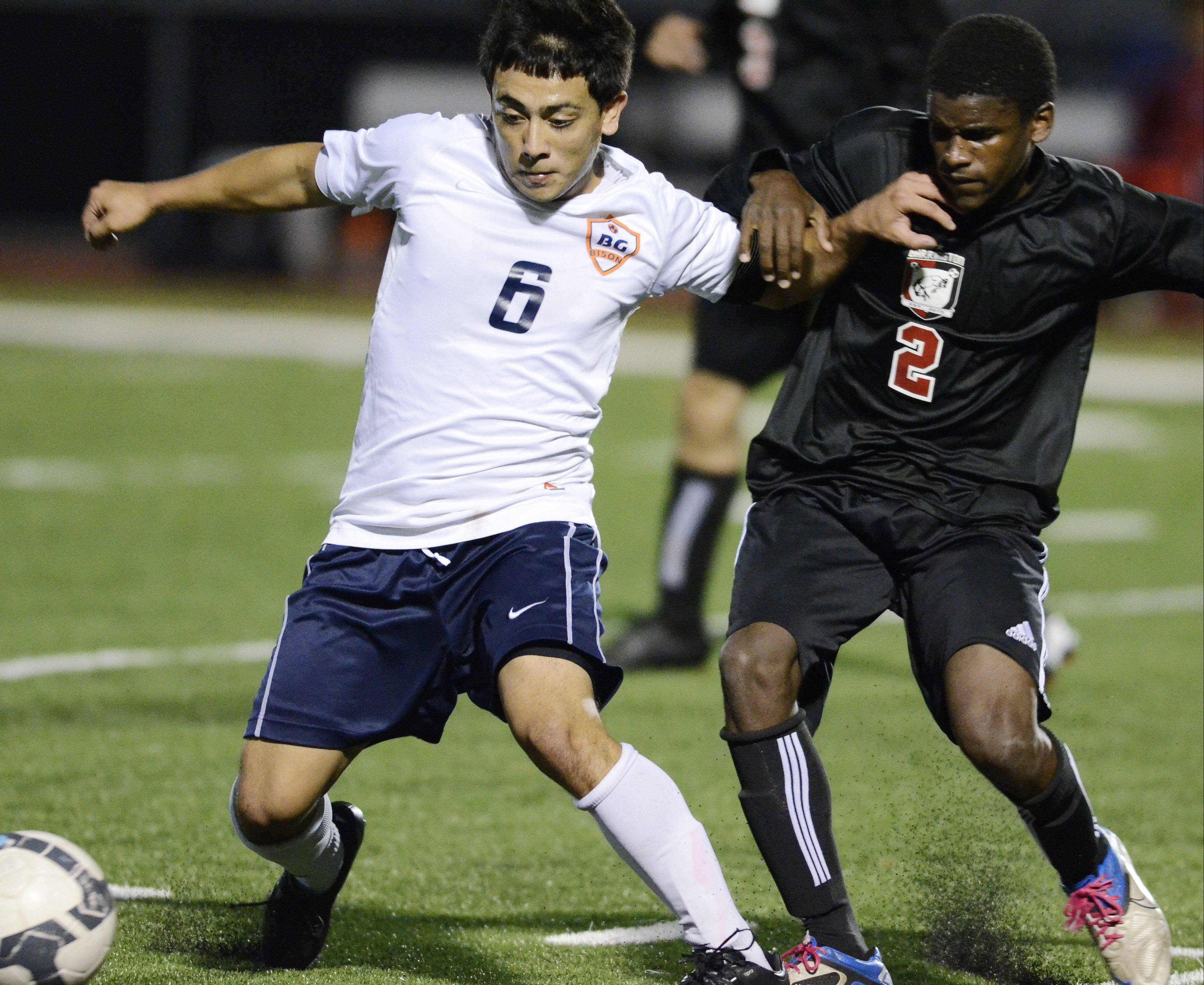 Buffalo Grove's Irving Eloiza, left, and Barrington all-area forward Kendall Stork make contact as they pursue the ball in an MSL contes