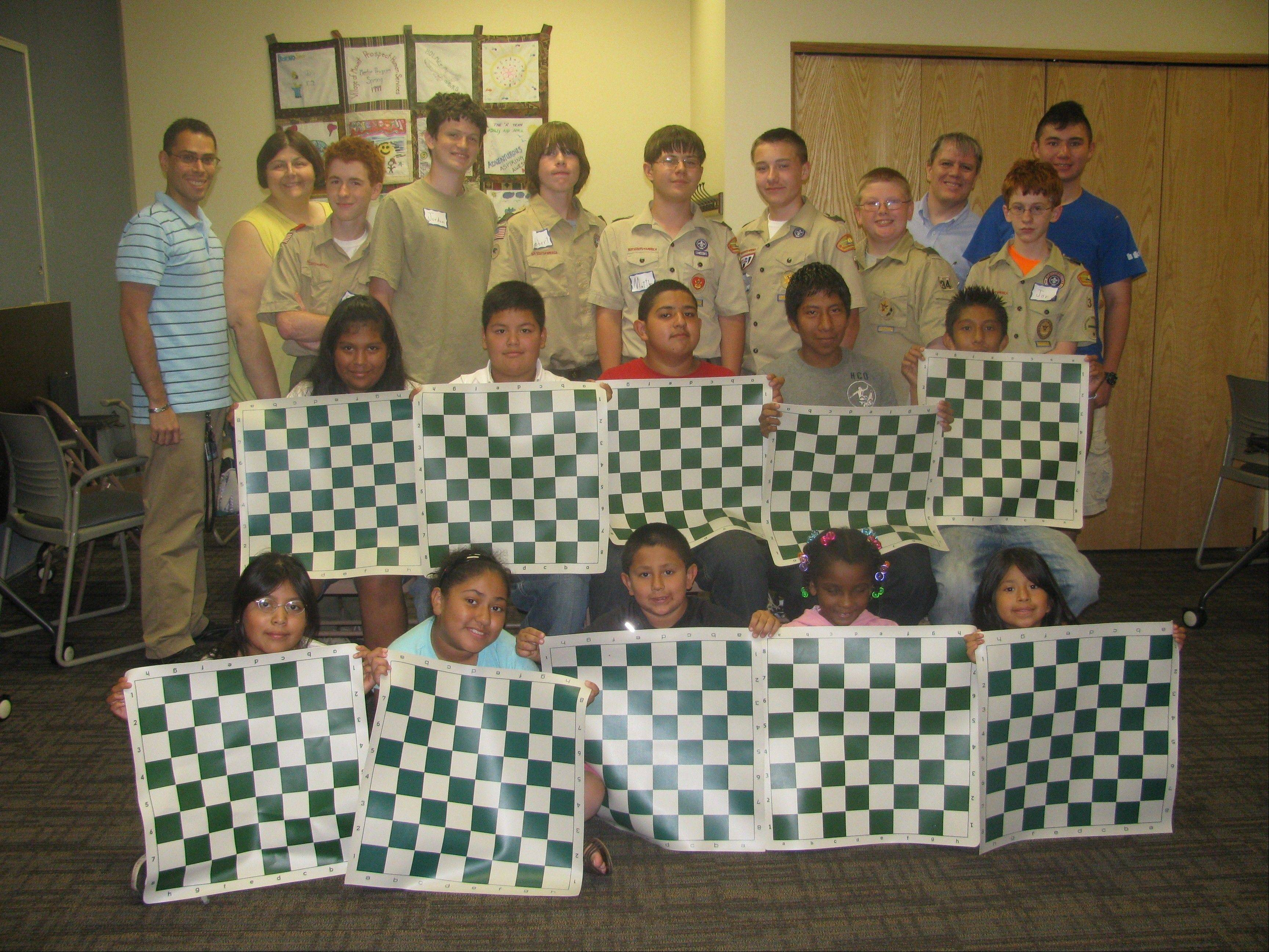 Matthew J. Wiewel's Eagle Scout Project taught 32 children how to play chess and provided them with free chess sets at the South Branch of the Mount Prospect Public Library.