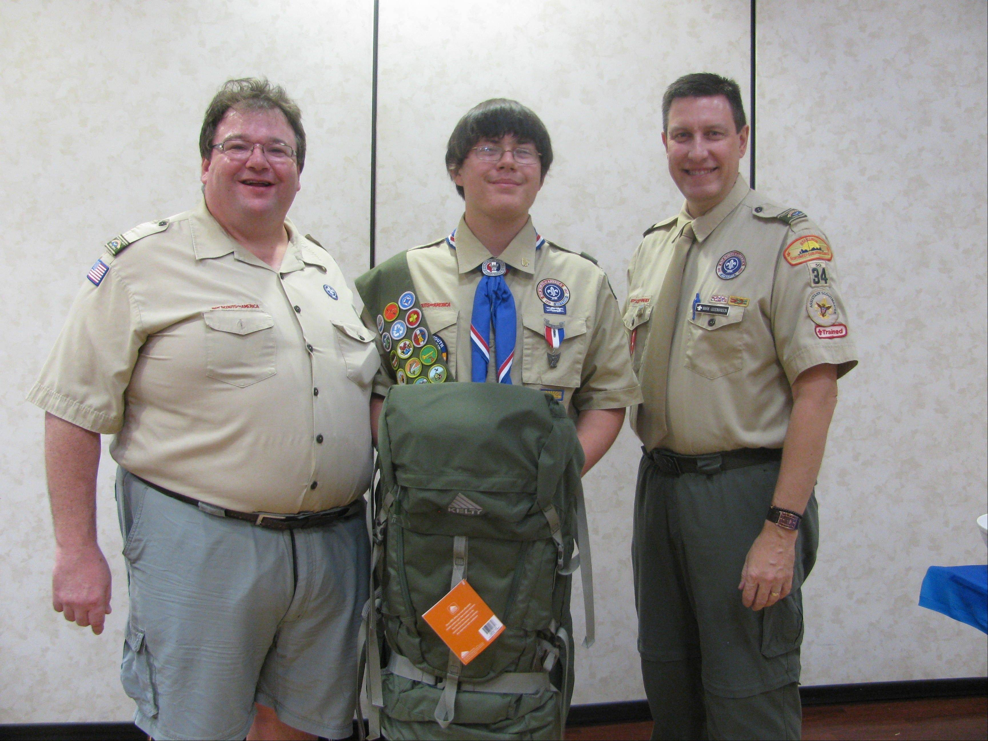From left, Scoutmaster Marc Mendelsohn Troop 34 Arlington Heights, Eagle Scout Matthew J. Wiewel and Scoutmaster Mark Goodmanson at Matthew's Eagle Court of Honor Sept. 30.