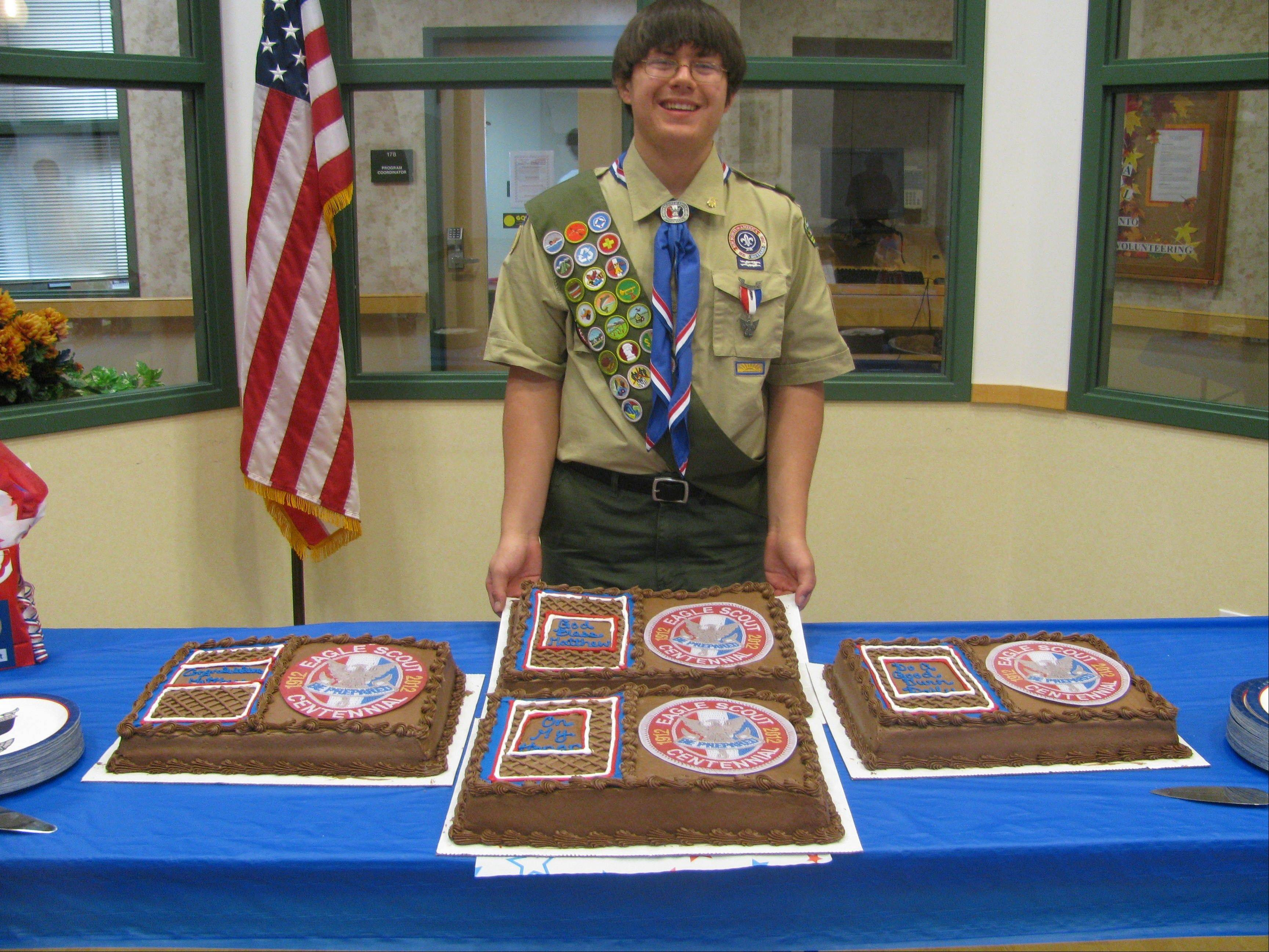 Eagle Scout Matthew J. Wiewel poses with his four Eagle Cakes at his recent Eagle Court of Honor.