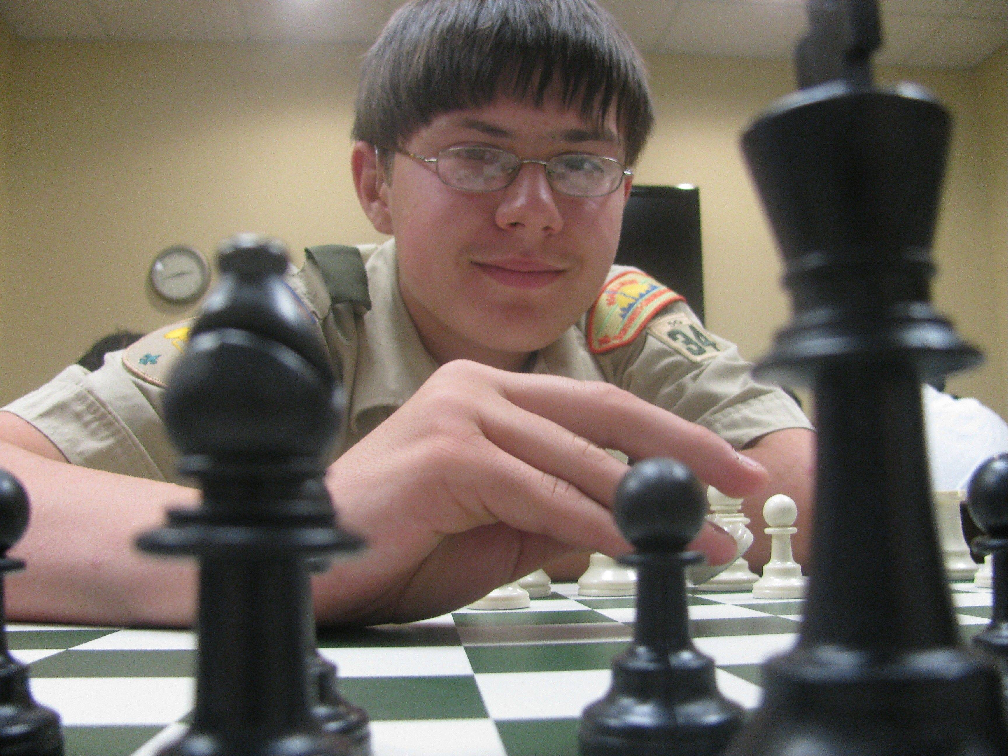 Eagle Scout Matthew J. Wiewel with chess pieces.
