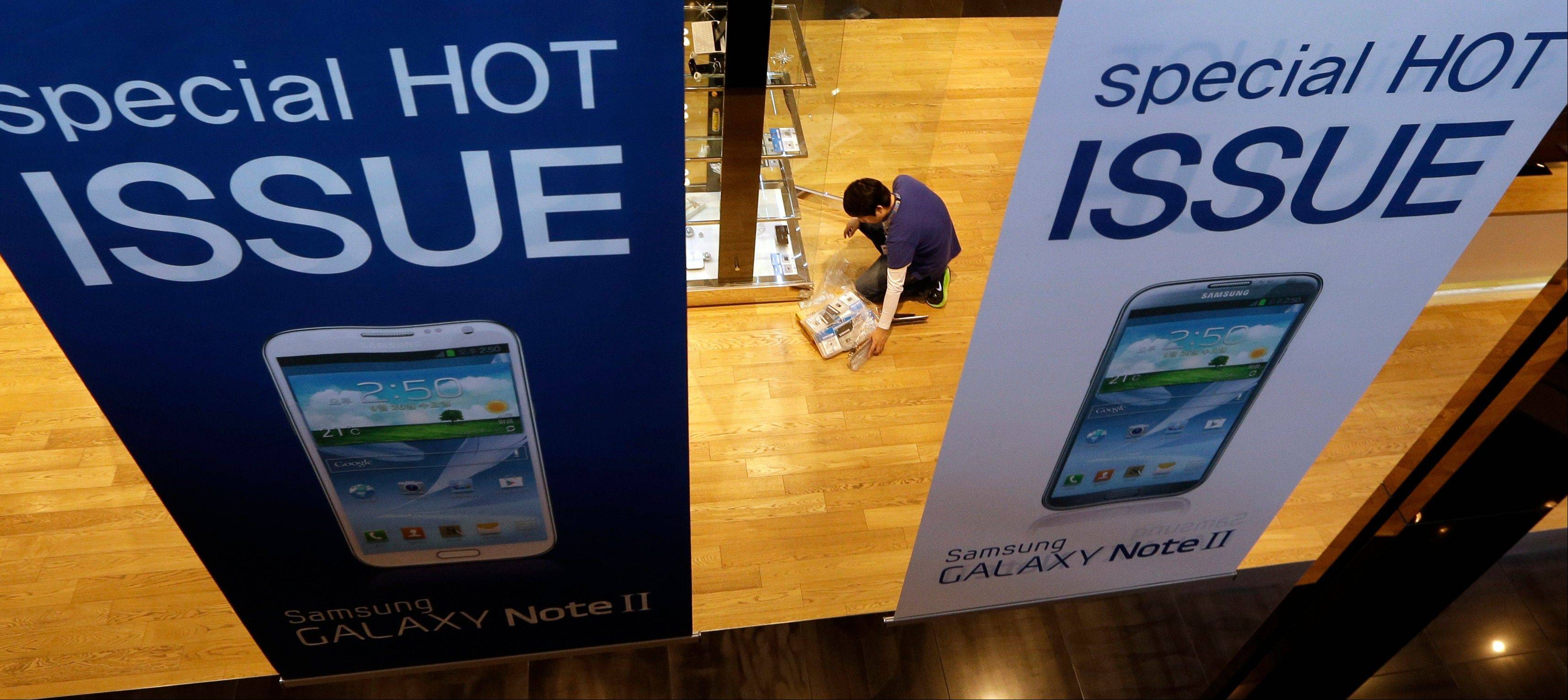 Samsung�s third-quarter net profit nearly doubled over a year earlier to a record high propelled by strong sales of Galaxy phones that helped widen its lead over rivals.