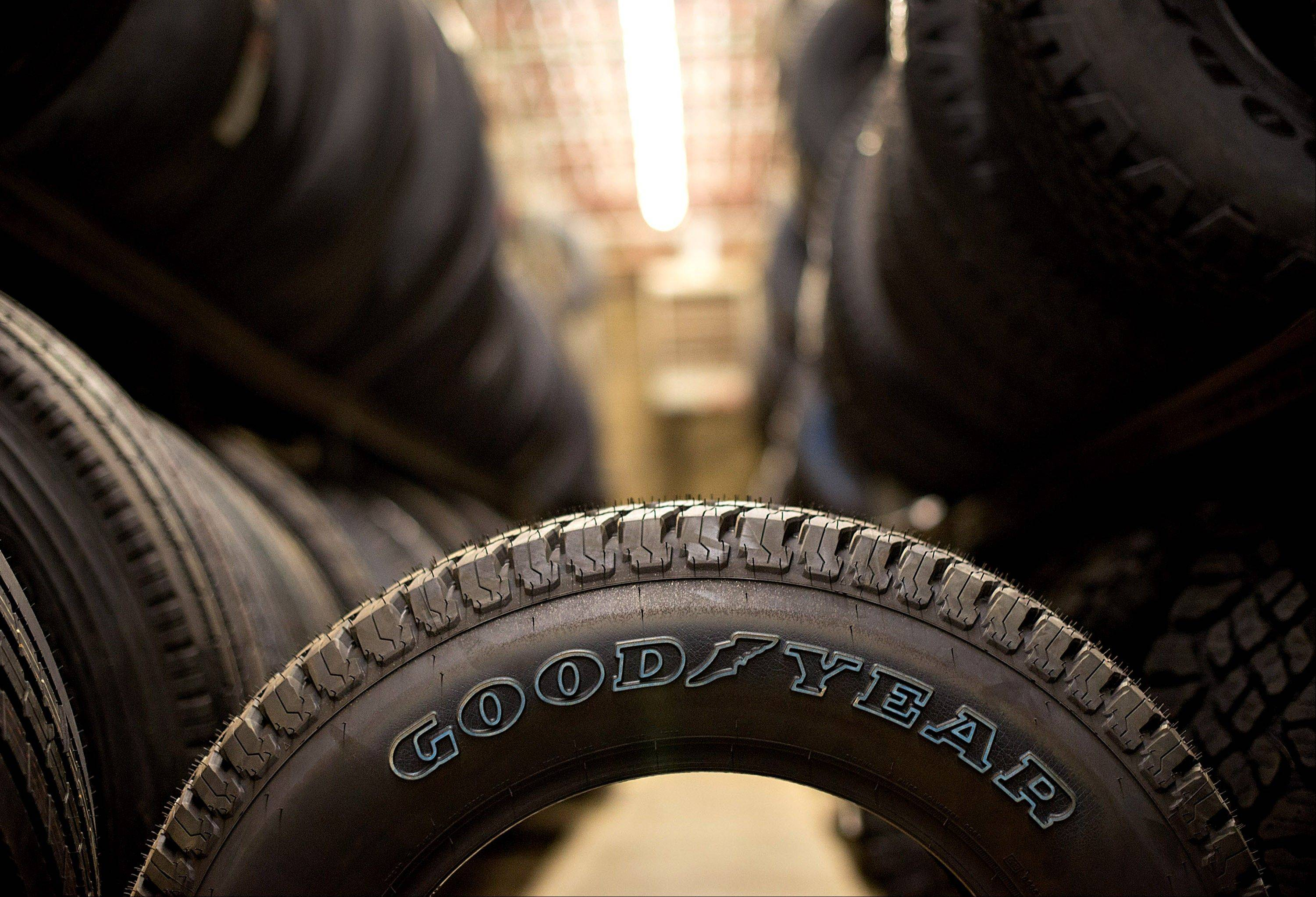 Goodyear Tire & Rubber Co. vehicle tires sit in a storage room at Keister�s Tire Center in Kewanee, Ill. The company�s stock fell 10 percent on Friday.