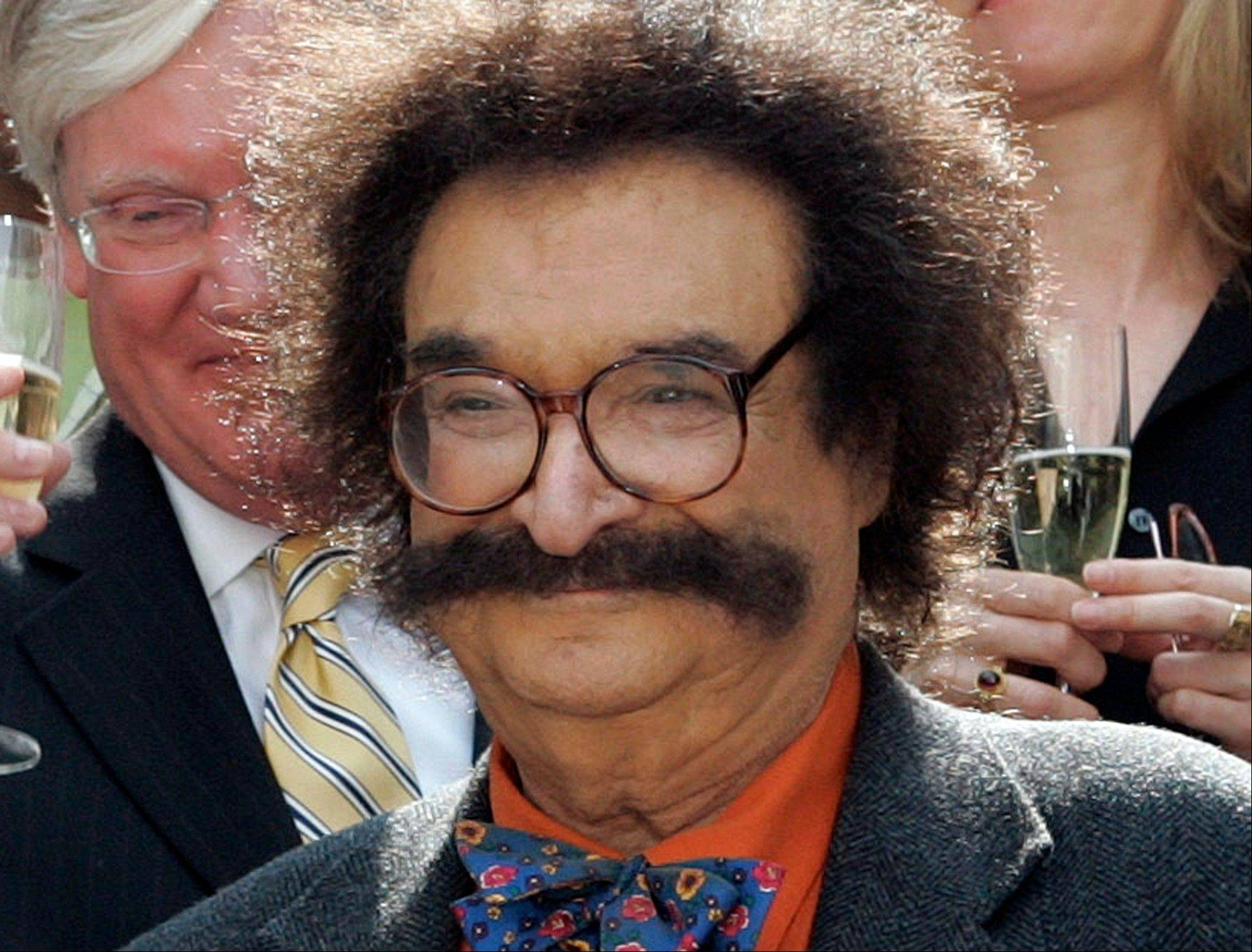 Film critic Gene Shalit, 86, faces a charge of driving to endanger after his vehicle struck a utility pole and came to rest against a home in Lenox, Mass., Wednesday, according to police.