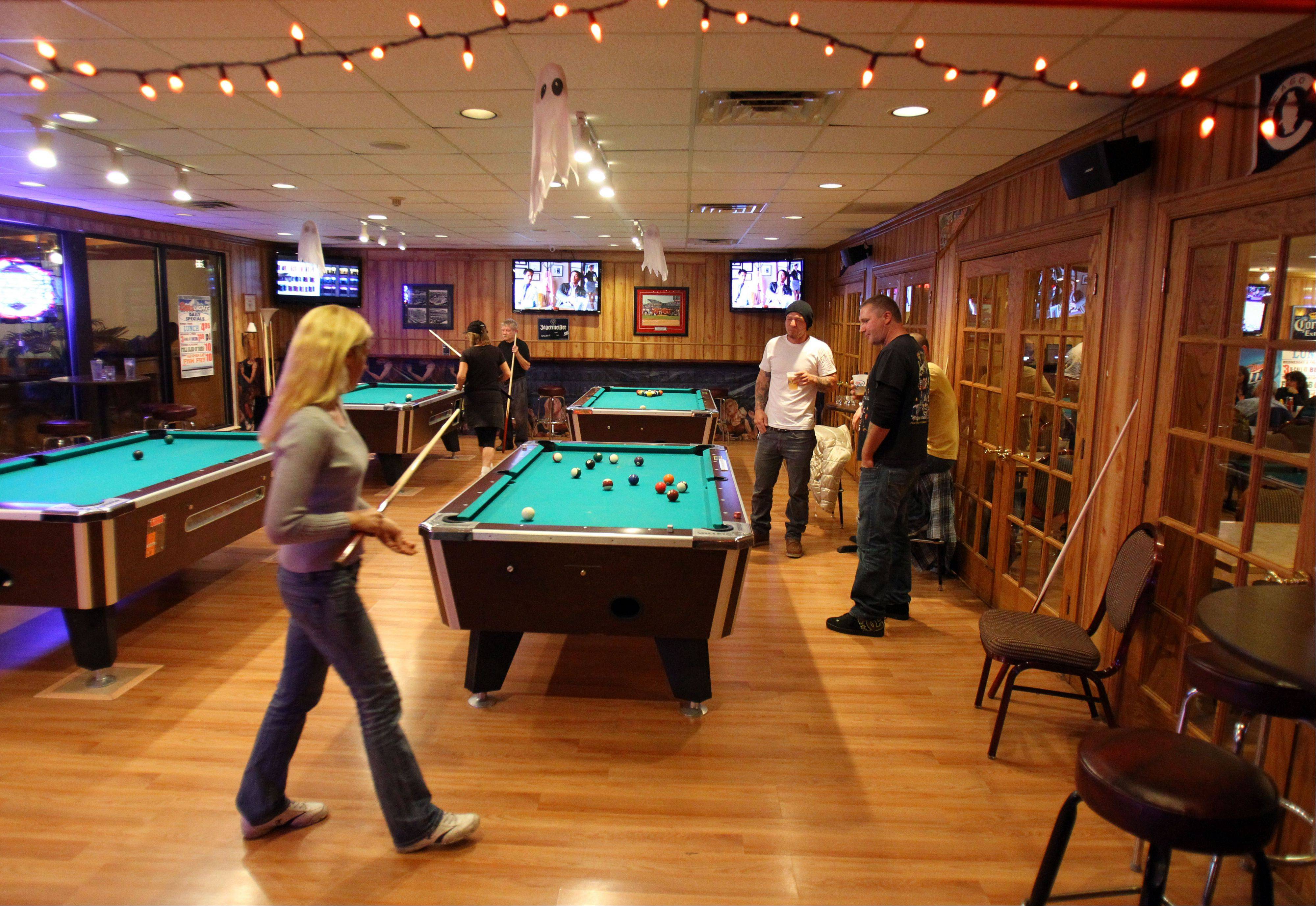 Patrons play pool at J&D Sports Bar & Grill in Wauconda.