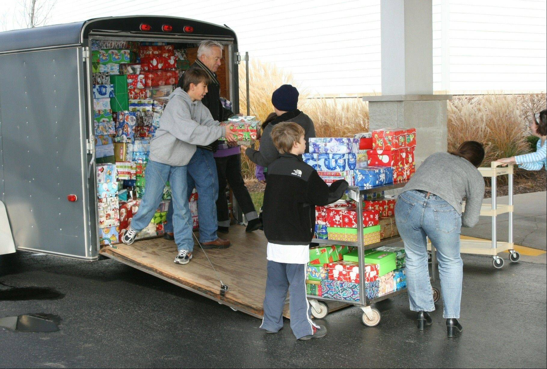 Volunteers for Operation Christmas Child move shoe box gifts containing supplies for needy children at the collections center at Crossroads Church in Grayslake. (Photo taken by Volunteer Area Coordinator Connie Pfeifer)