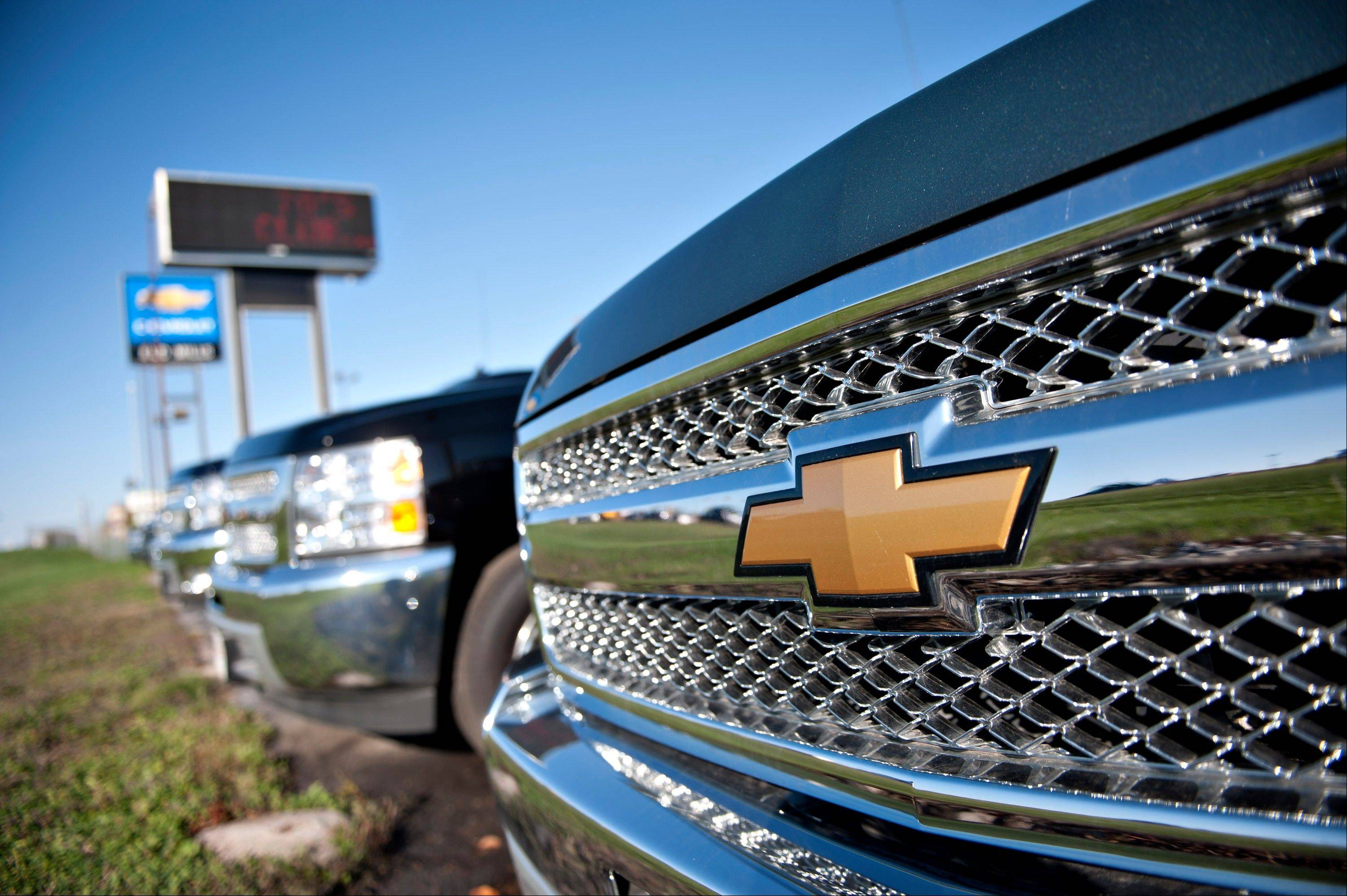 Bloomberg News Chevrolet Silverado trucks sit on the lot at Bud Mills Chevrolet auto dealership Friday in Moline, Ill. The U.S. Census Bureau will release figures on domestic auto sales on Nov. 1.