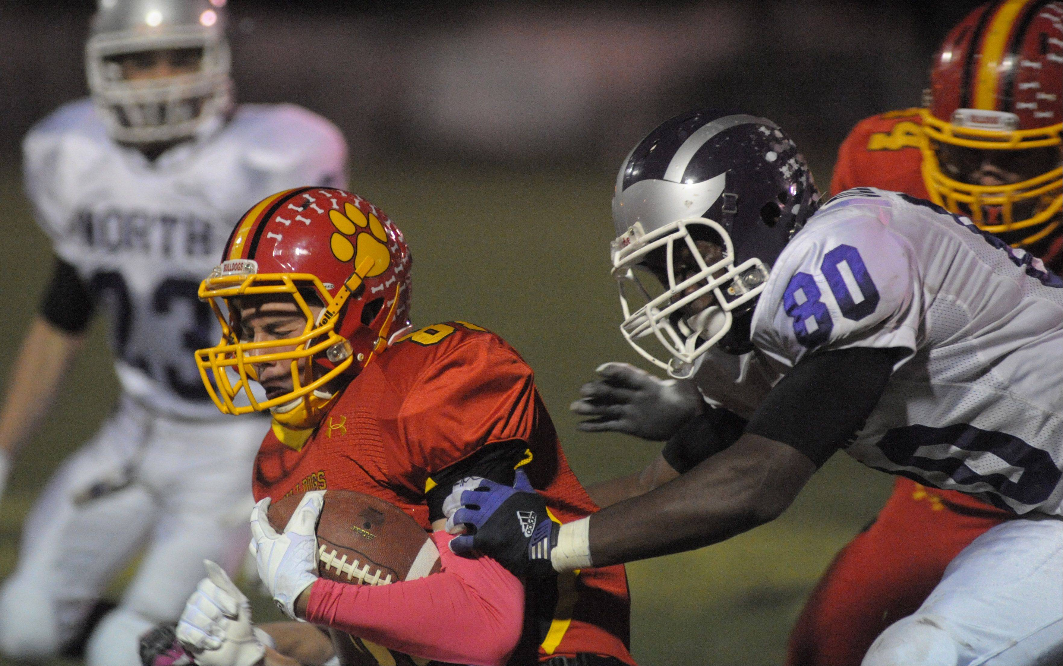 Downers Grove North�s Richard Olekanma takes down Batavia�s Jason Toth in the fourth quarter of playoff game on Friday, October 26.