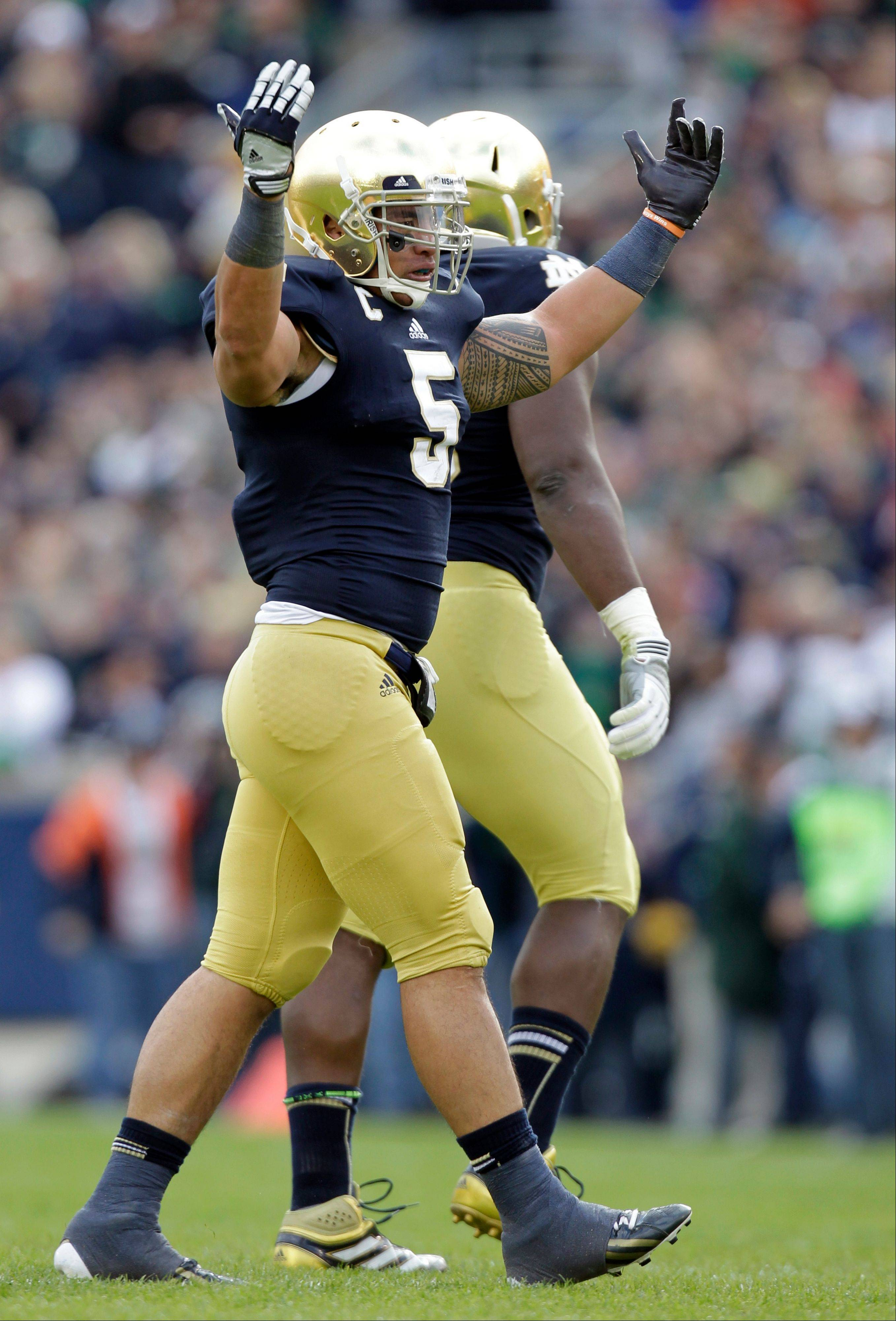 Notre Dame linebacker Manti Te�o celebrates after an interception against BYU last Saturday in South Bend, Ind. Notre Dame has built its undefeated start behind Te�o and the nation�s second-stingiest defense.