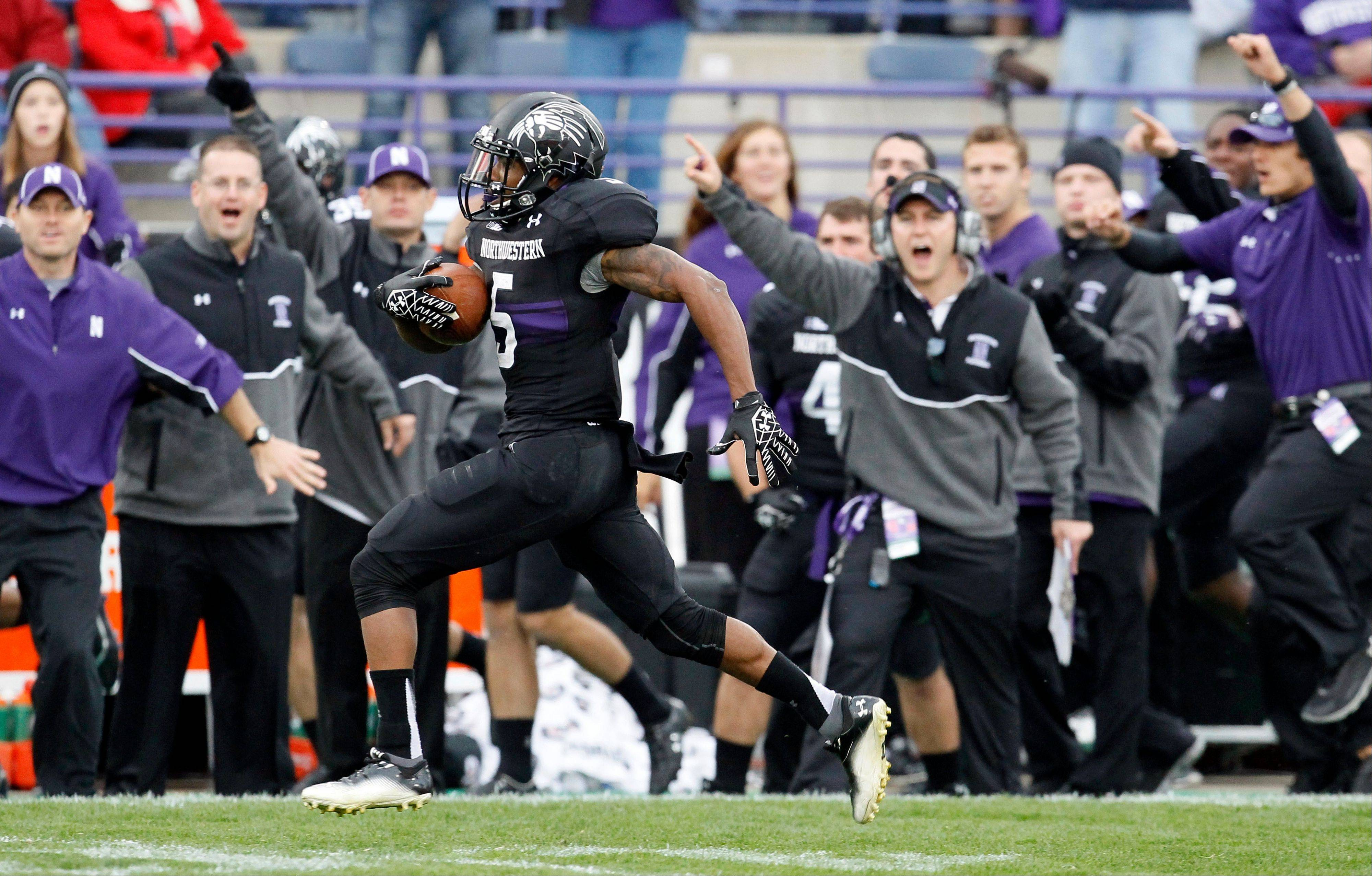 Northwestern running back Venric Mark, here heading for an 80-yard touchdown against Nebraska, leads the Big Ten in all-purpose yards per game and has rushed for more than 100 yards in five games this season.
