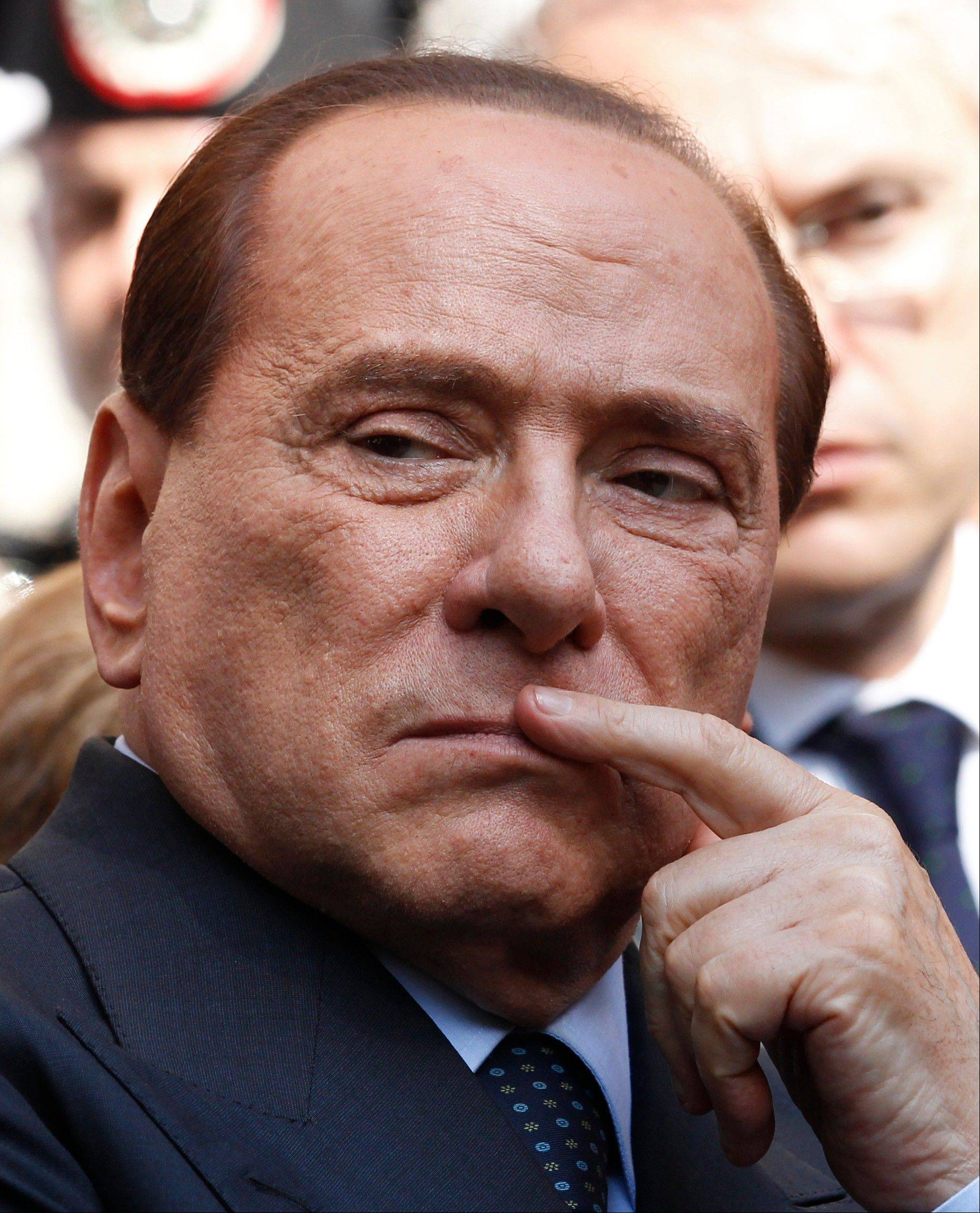 A court in Italy has convicted former Premier Silvio Berlusconi of tax fraud and sentenced him to four years in prison.