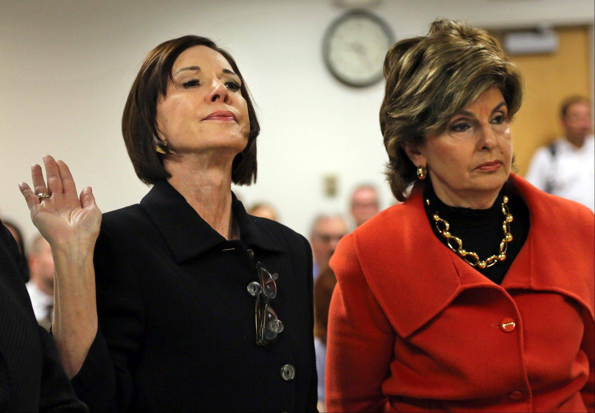 Maureen Sullivan Stemberg, left, ex-wife of Staples founder Tom Stemberg, and her lawyer Gloria Allred, stand in Norfolk County Probate Court Thursday, in Canton, Mass.