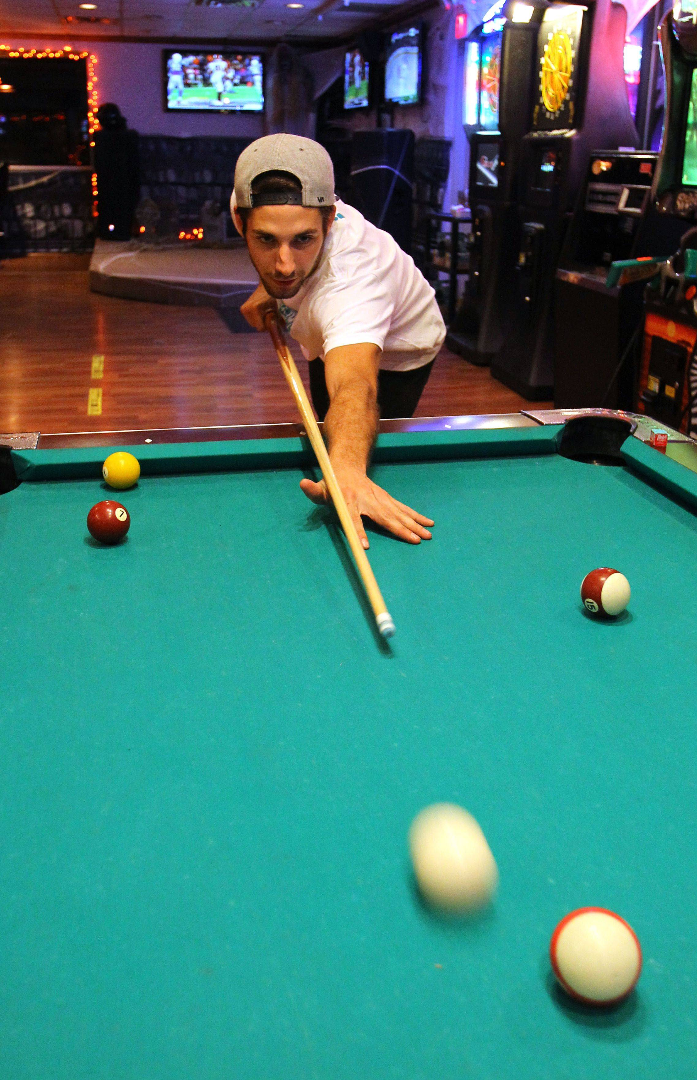 Brett Kidd of Wauconda plays pool at J&D Sports Bar & Grill in Wauconda.
