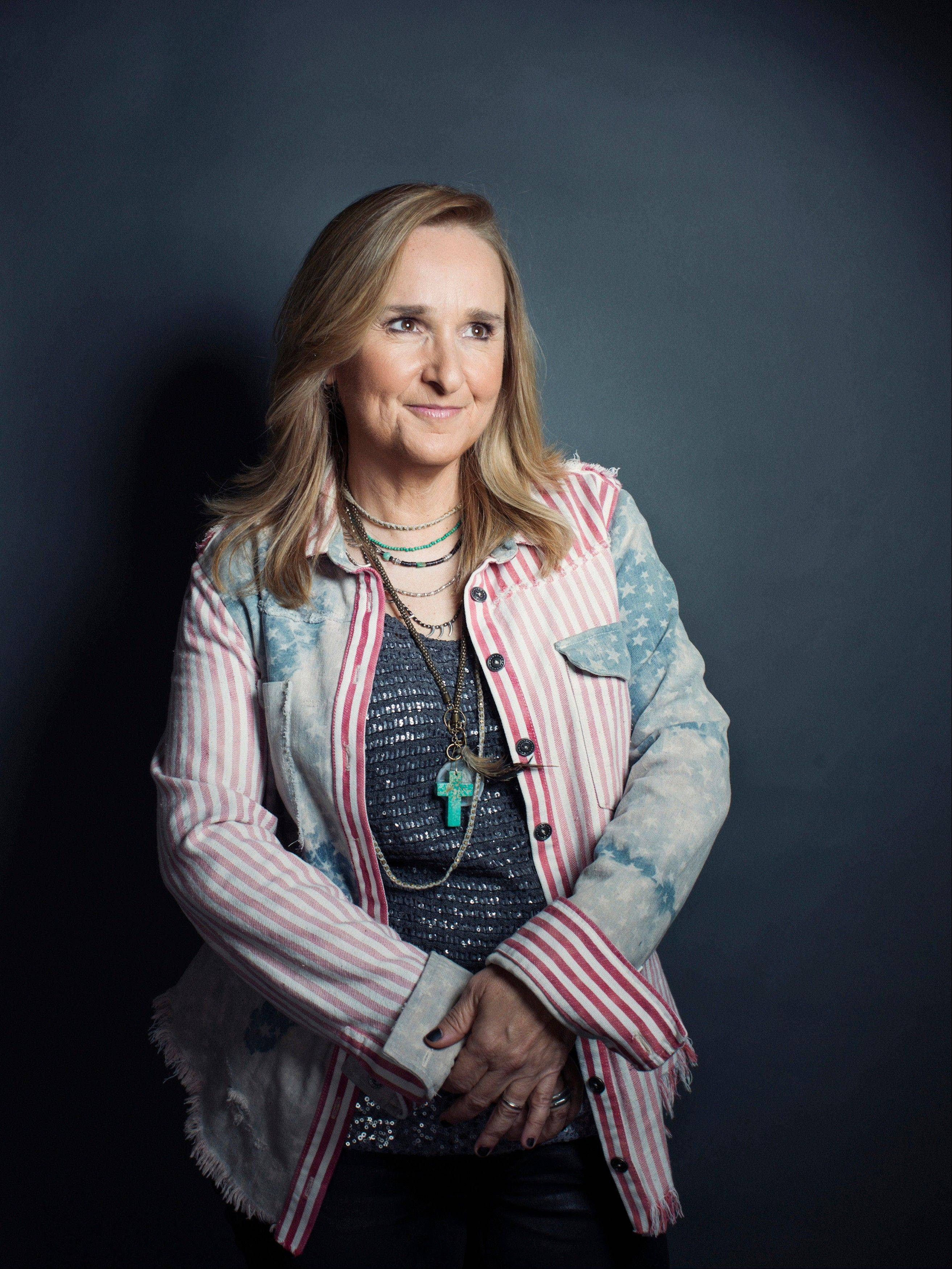 "Singer-songwriter Melissa Etheridge challenged herself to play all the guitar parts on her new CD ""4th Street Feeling."""